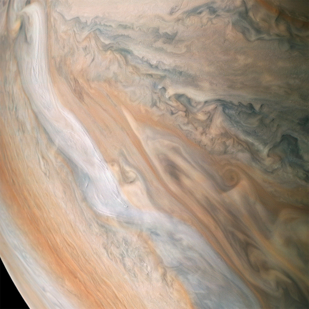 NASA's Juno spacecraft shows a white jet stream speeding through Jupiter's atmosphere. The jet stream, called Jet N2, was captured along the dynamic northern temperate belts of the gas giant planet.