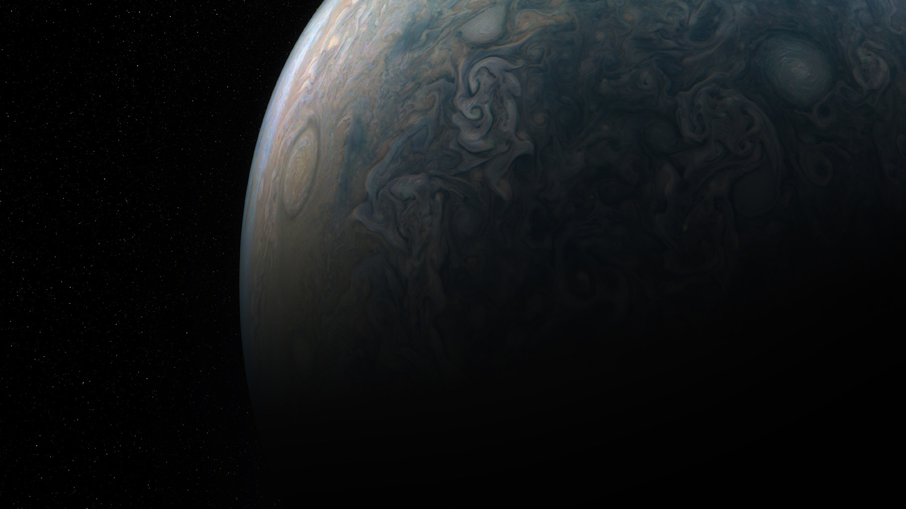 Tumultuous tempests in Jupiter's northern hemisphere are seen in this portrait taken by NASA's Juno spacecraft. Jupiter has cyclones and anticyclones, along with fast-moving jet streams that circle its globe.