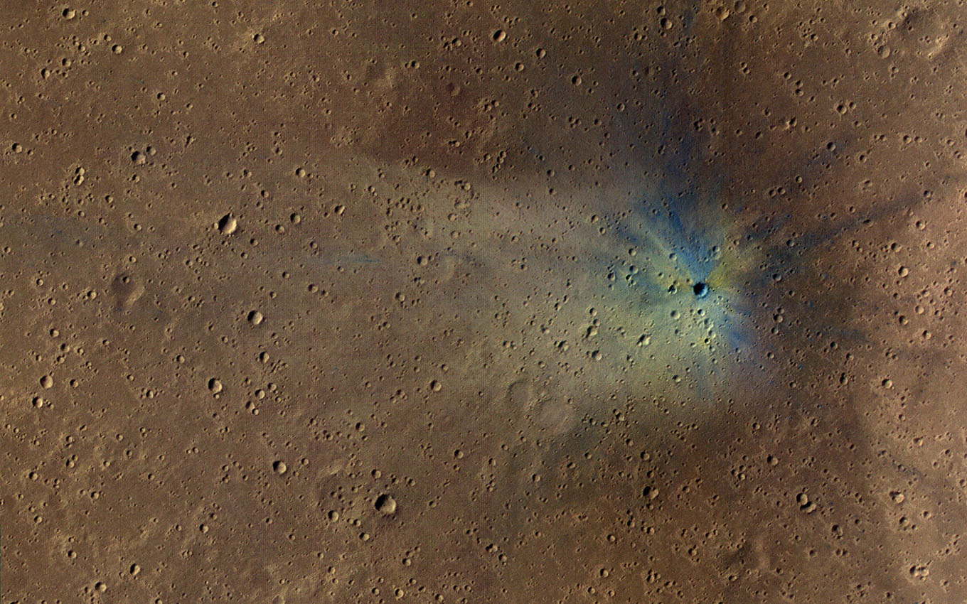 NASA's Mars Reconnaissance Orbiter continually finds new impact sites on Mars. This one occurred within the dense secondary crater field of Corinto Crater. The new crater and its ejecta have distinctive color patterns.