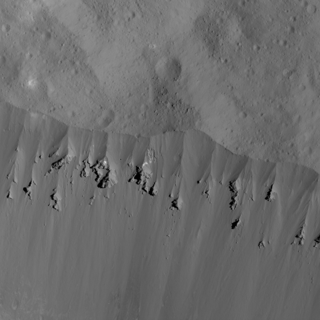 This image of landslides along Ceres' Occator Crater's eastern rim was obtained by NASA's Dawn spacecraft on June 9, 2018 from an altitude of about 27 miles (44 kilometers).