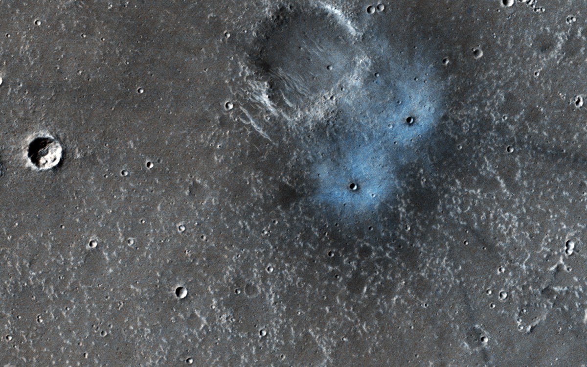 NASA's Mars Reconnaissance Orbiter observed this image of an impact crater. The blue appearance is due to the intense blast of the impact moving around dust on the surface. That dust is usually light-toned and reddish in color compared to what is beneath.