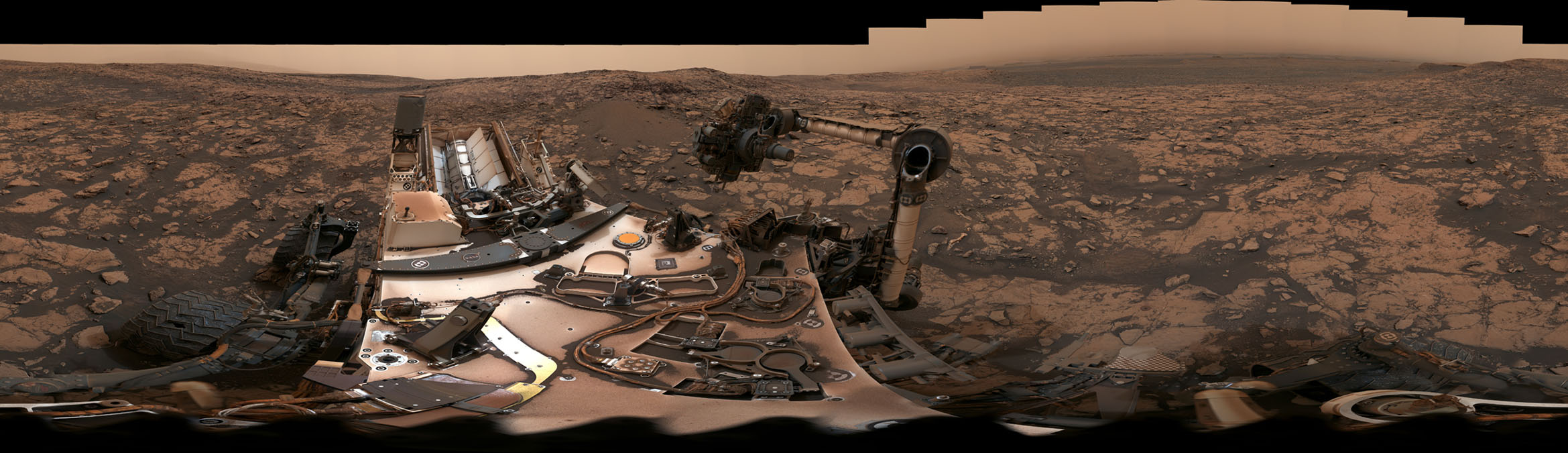 NASA's Curiosity rover surveyed its surroundings on Aug. 9, 2018, showing its current location on Mars' Vera Rubin Ridge. The panorama includes skies darkened by a fading global dust storm and a rare view of the rover itself.