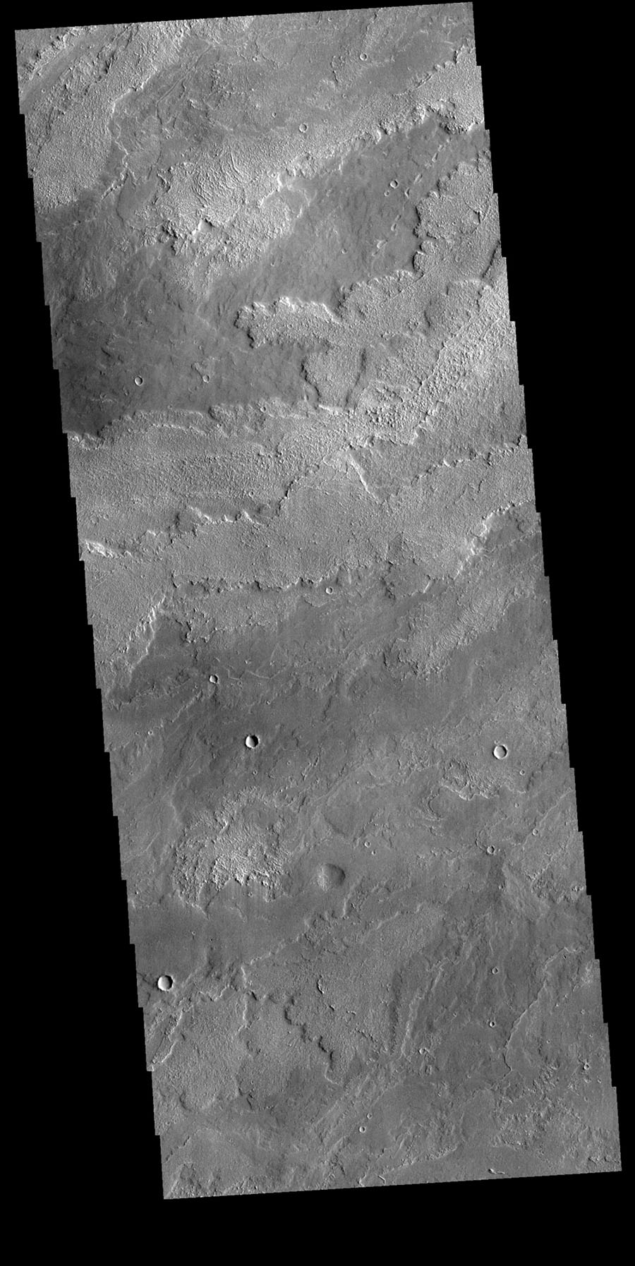 This image from NASA's Mars Odyssey shows the lava flows originating at Arsia Mons. Arsia Mons in the southermost of the three large Tharsis volcanoes.