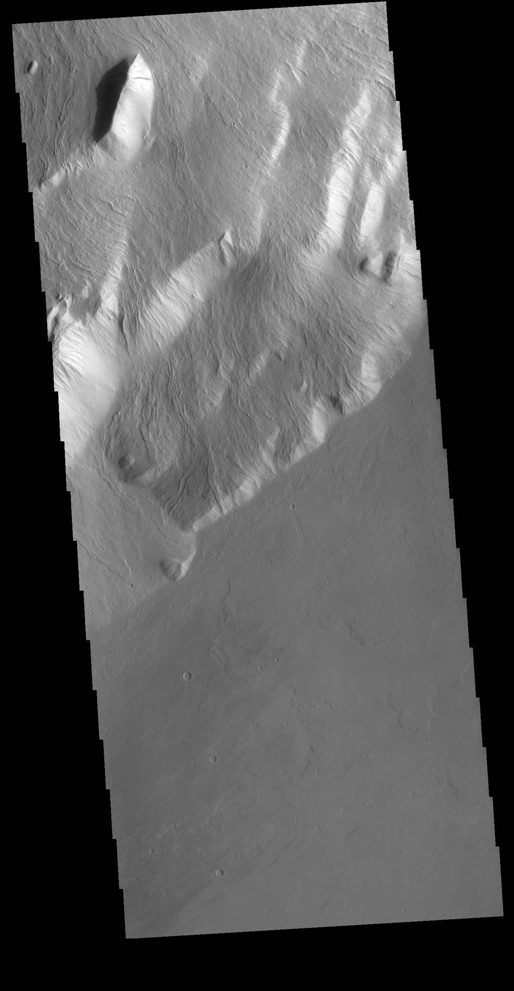 This image from NASA's Mars Odyssey shows Olympus Rupes, the large escarpment surrounding Olympus Mons. The escarpment is a cliff where there is a large elevation change over a short distance.