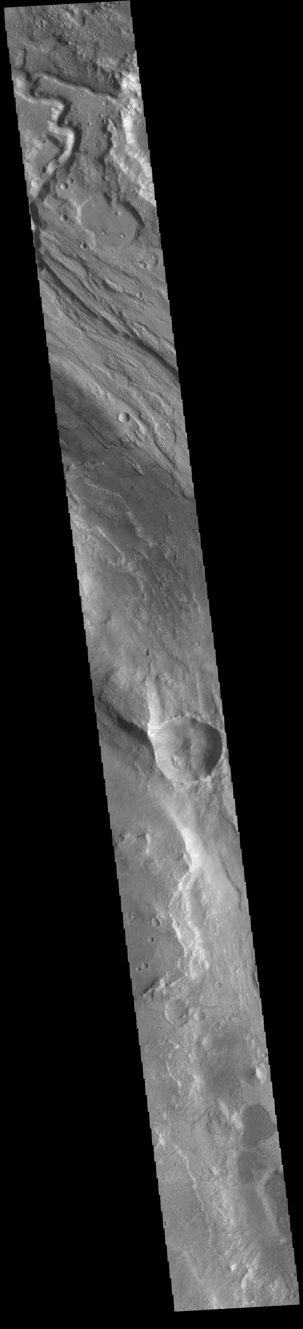 This image from NASA's Mars Odyssey shows part of Ares Vallis, one of the large channels in Margaritfer Terra that empty into Chryse Planitia.