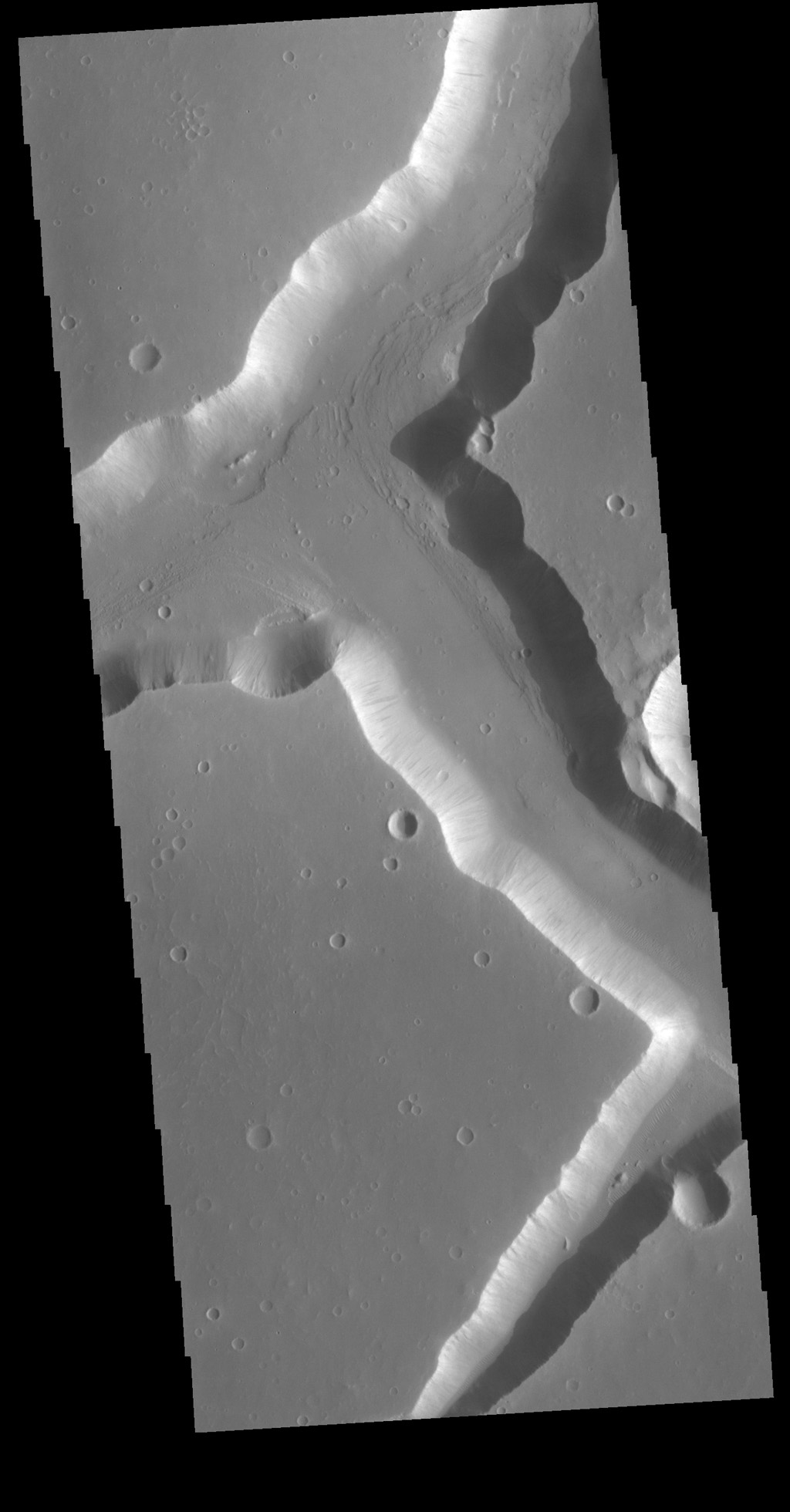 This image from NASA's Mars Odyssey shows right angle intersections from some of the graben that form Sacra Fossae. The fossae are located on the margin of Lunae Planum near the beginning of Kasei Valles.