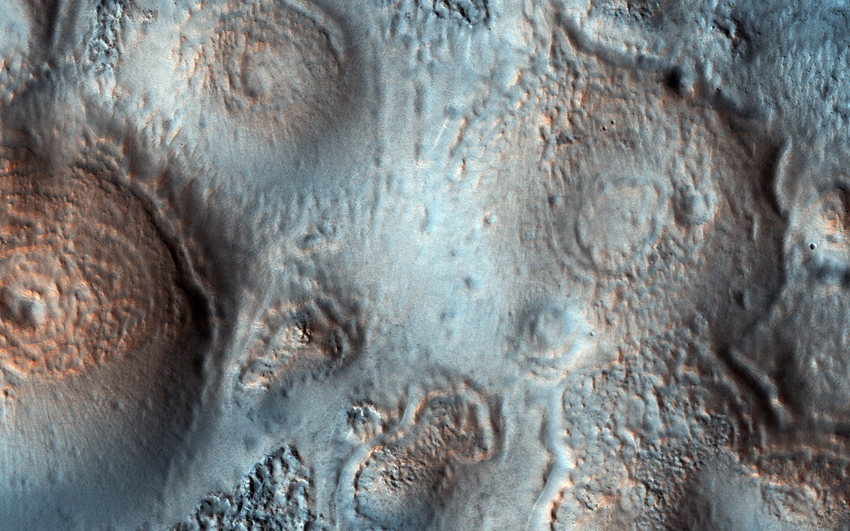 This image acquired on May 15, 2018 by NASA's Mars Reconnaissance Orbiter, shows relatively bright mounds scattered throughout darker and diverse surfaces in Chryse Planitia.