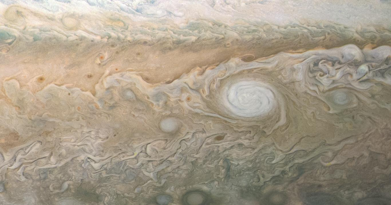 A swirling, oval white cloud in Jupiters South South Temperate Belt is captured in this image from NASAs Juno spacecraft.