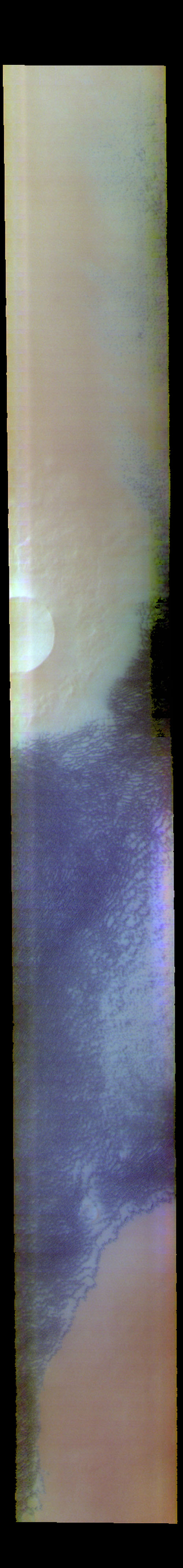 This image from NASA's Mars Odyssey shows sand dunes located near Escorial Crater and the north polar cap. The dune field is called Siton Undae.