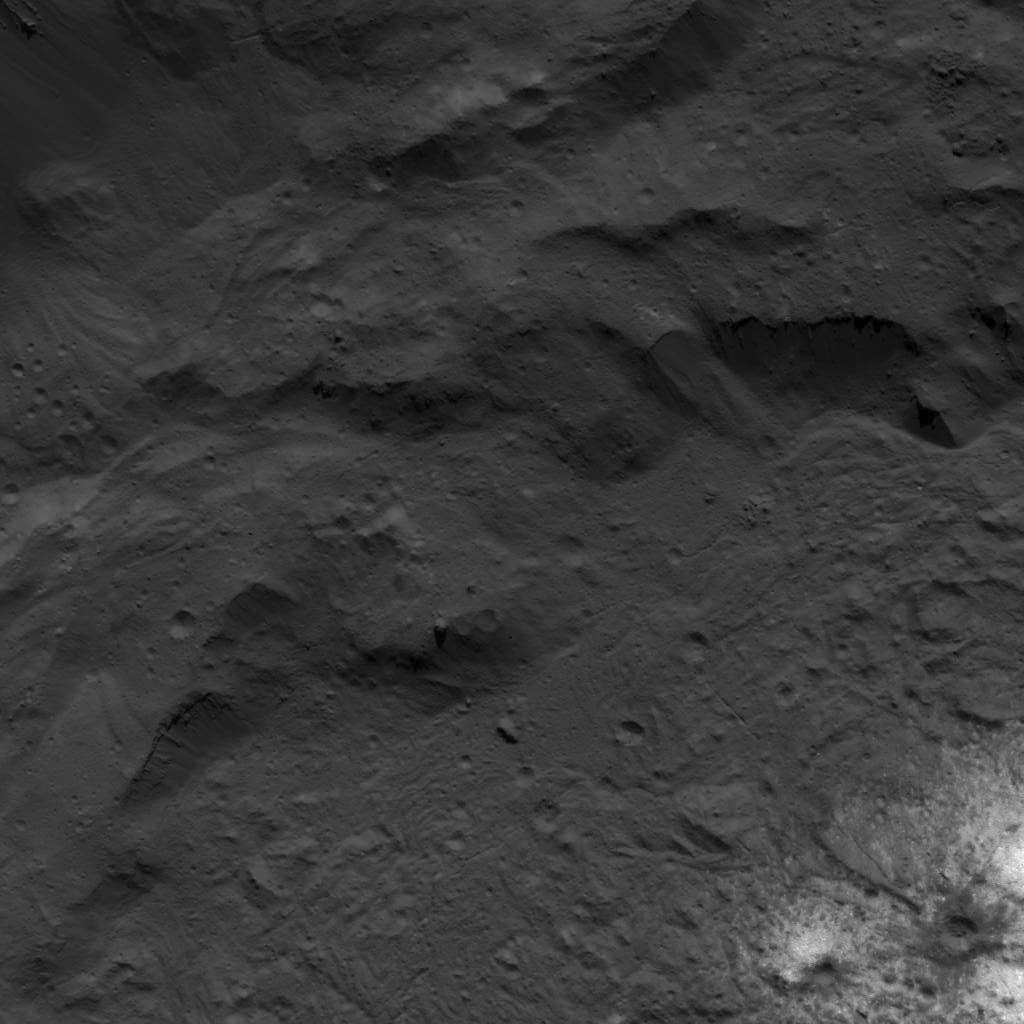 This image of the base of Occator Craters eastern wall next to the Vinalia Faculae was obtained by NASAs Dawn spacecraft on July 23, 2018 from an altitude of about 84 miles (135 kilometers).