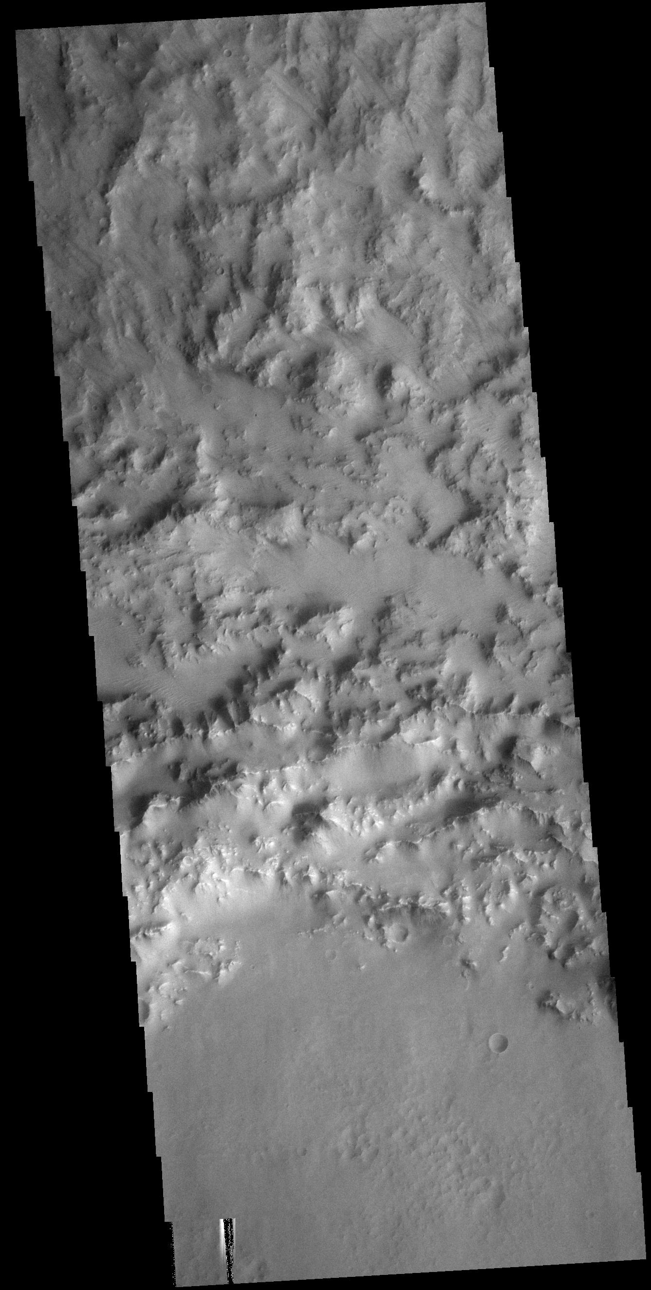 This image from NASAs Mars Odyssey shows part of the northern rim of an unnamed crater in Hesperia Planum.