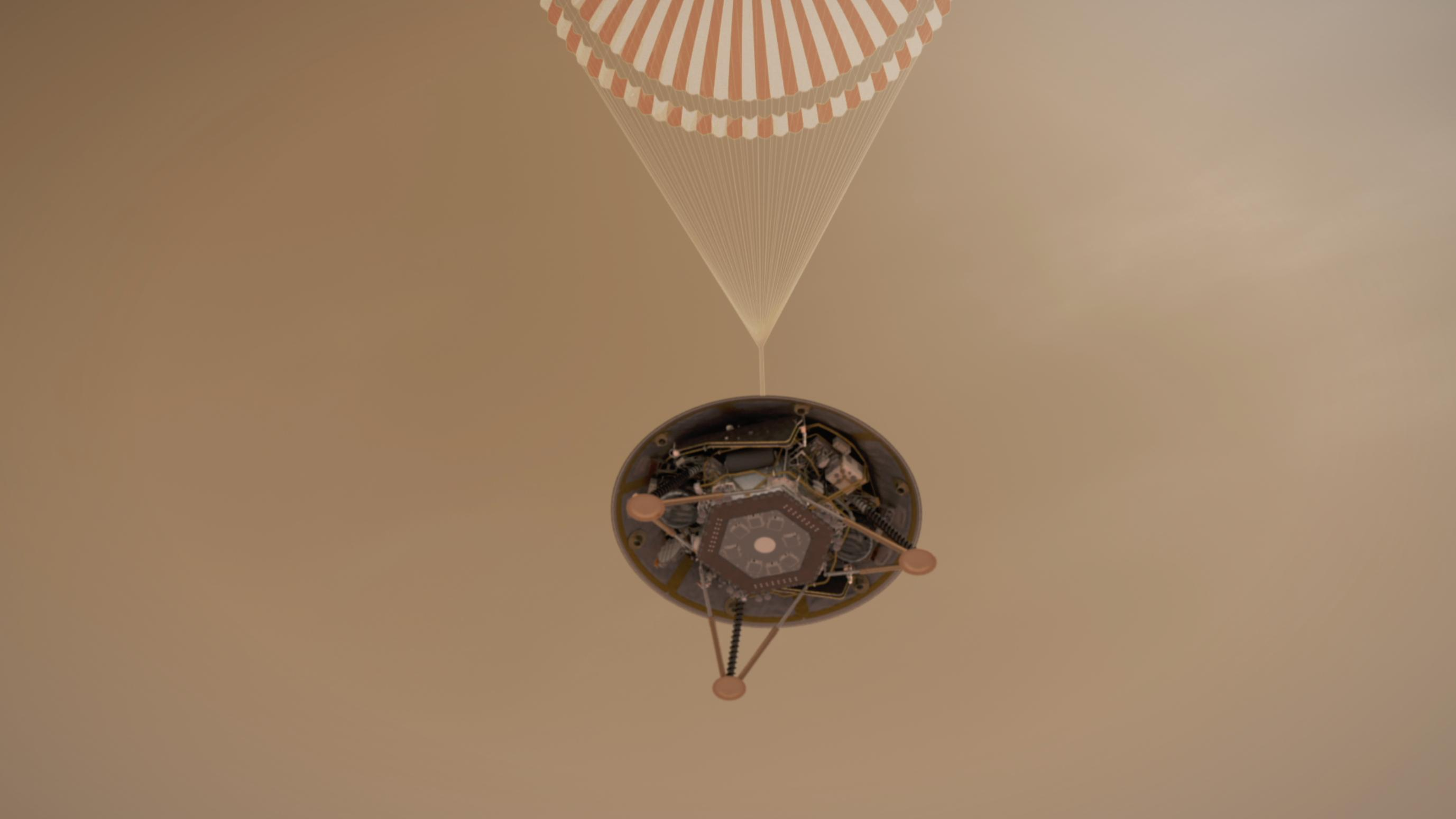 This illustration shows a simulated view of NASAs InSight lander descending towards the surface of Mars on its parachute.