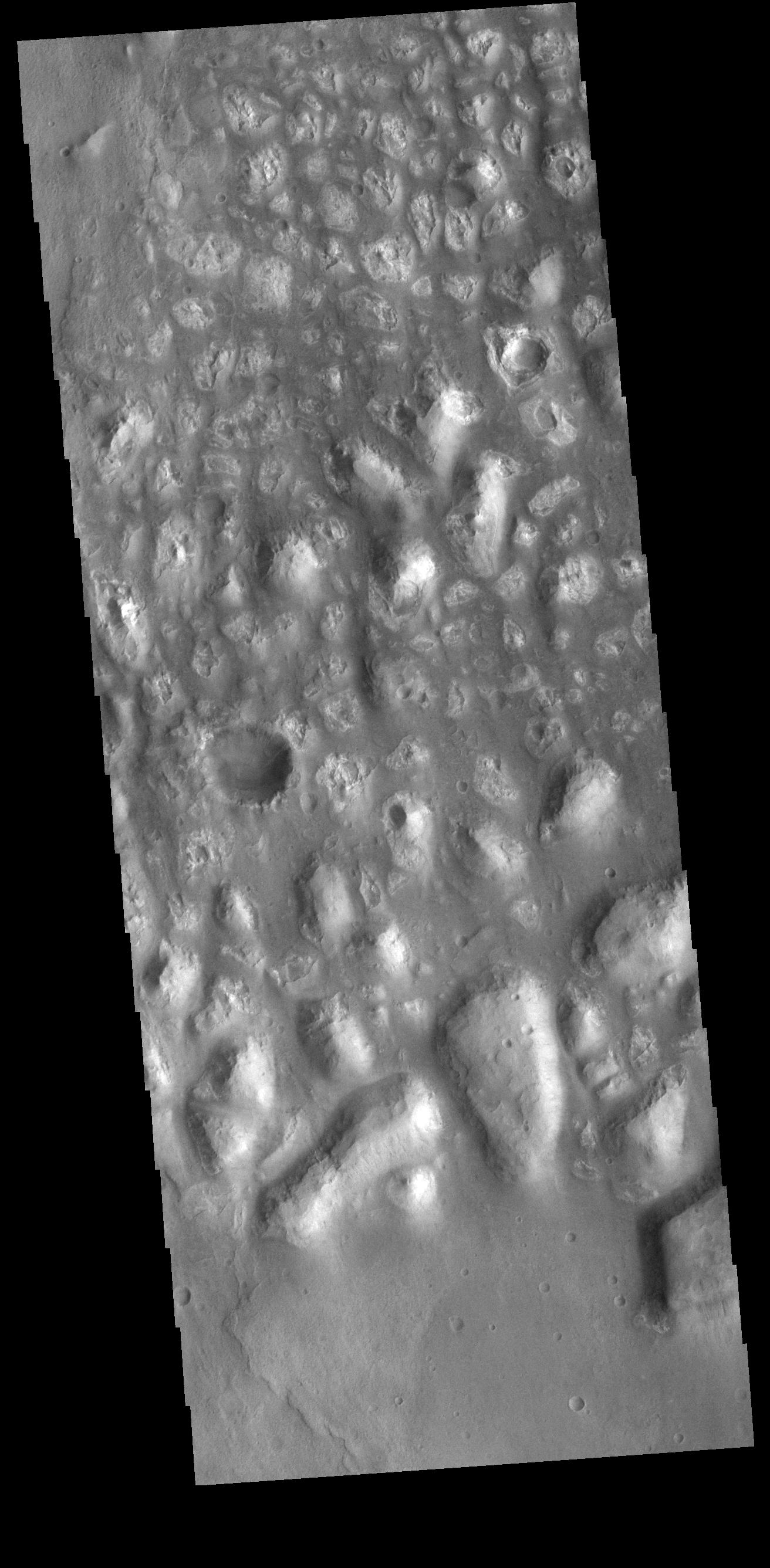 This image from NASAs Mars Odyssey shows Terra Cimmeria. The bright, irregular features are hills.