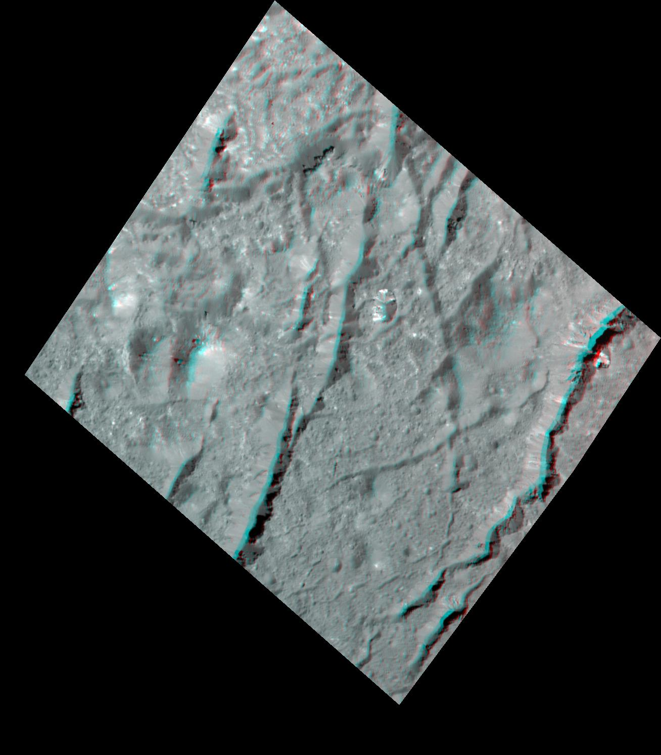This stereo view, called an anaglyph, of cracks in the floor of Occator Crater on Ceres was obtained by NASAs Dawn spacecraft from an altitude of about 22 miles (35 kilometers).