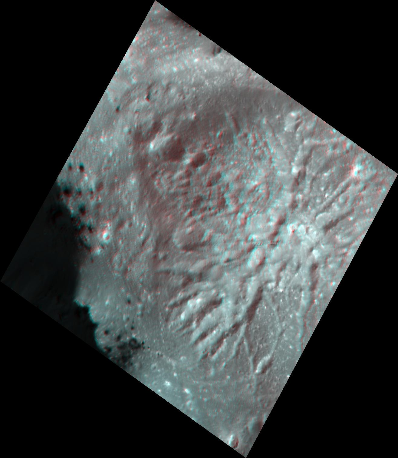 This stereo view, called an anaglyph, of Cerealia Facula Pit and Dome on Ceres was obtained by NASAs Dawn spacecraft from an altitude of about 21 miles (34 kilometers).