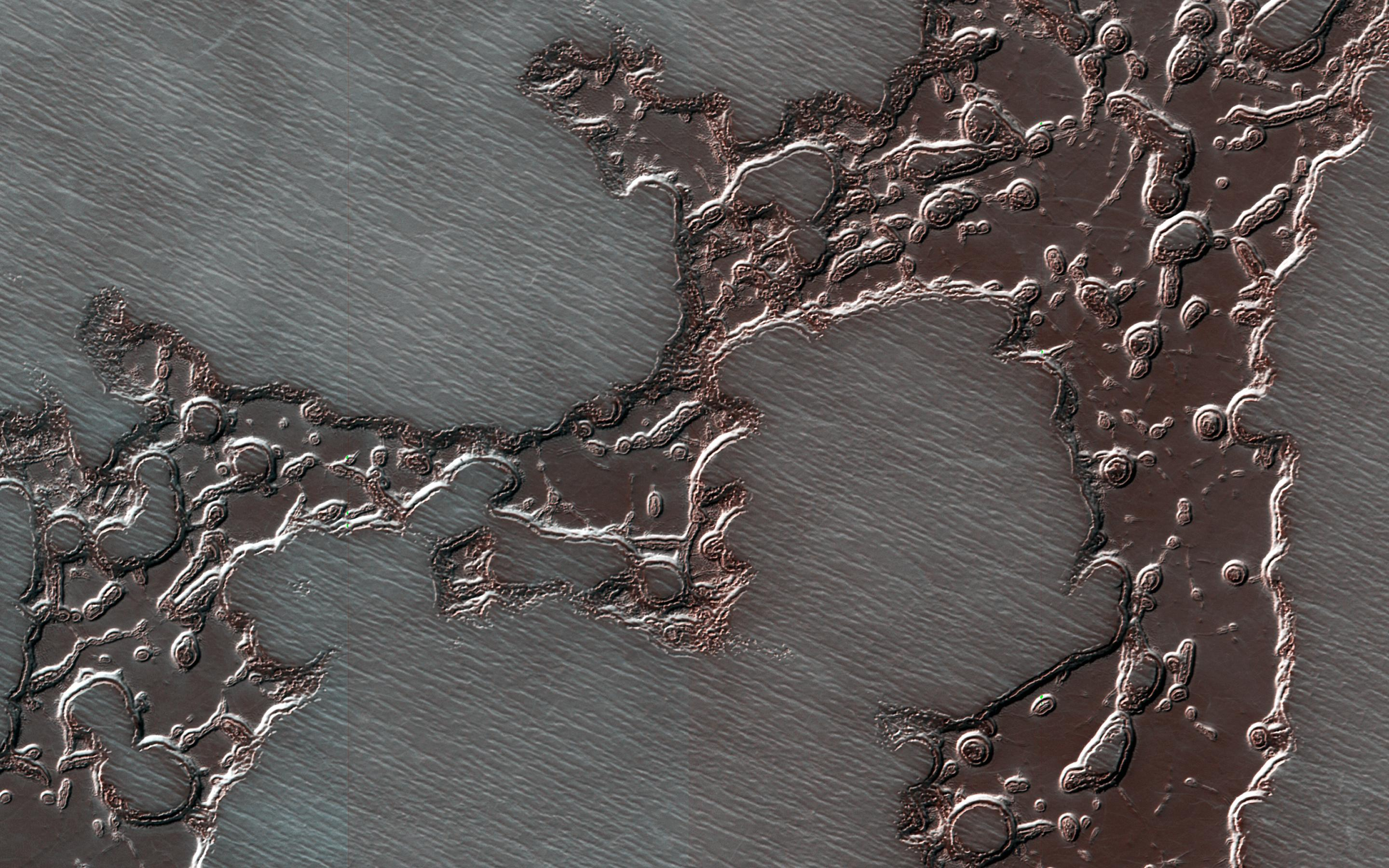 This image acquired on August 20, 2018 by NASAs Mars Reconnaissance Orbiter, shows remnants of a deposit, composed of dry ice layered together with dust and water ice, that form the south polar residual cap.