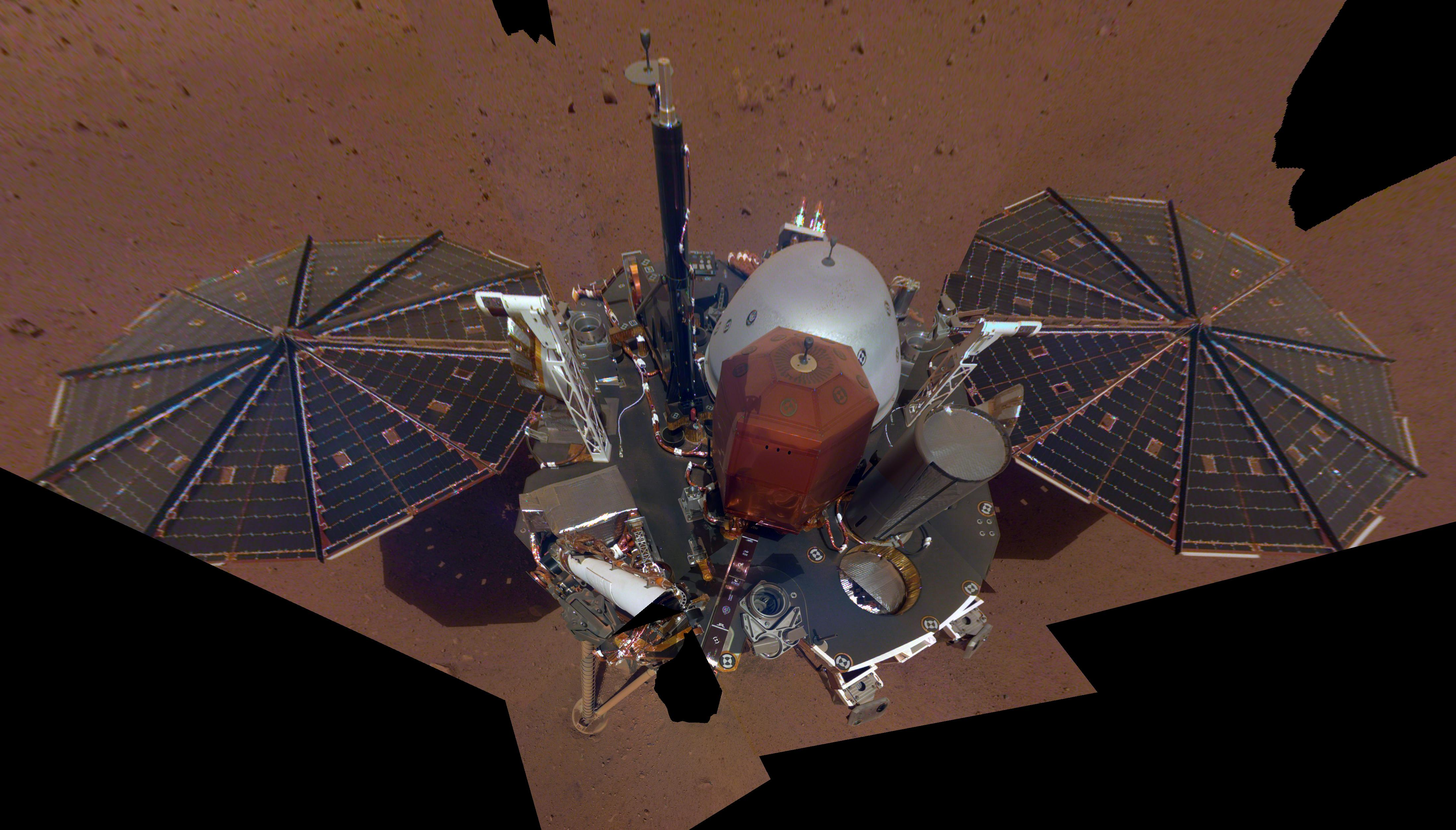 This is NASA InSights first selfie on Mars. It displays the landers solar panels and deck. On top of the deck are its science instruments, weather sensor booms and UHF antenna.