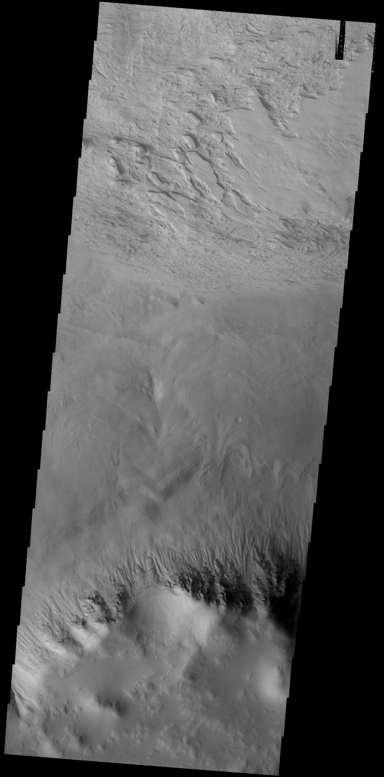 This image from NASAs Mars Odyssey shows a small portion of the floor of Galle Crater. This large crater is located on the eastern side of Argyre Planitia.