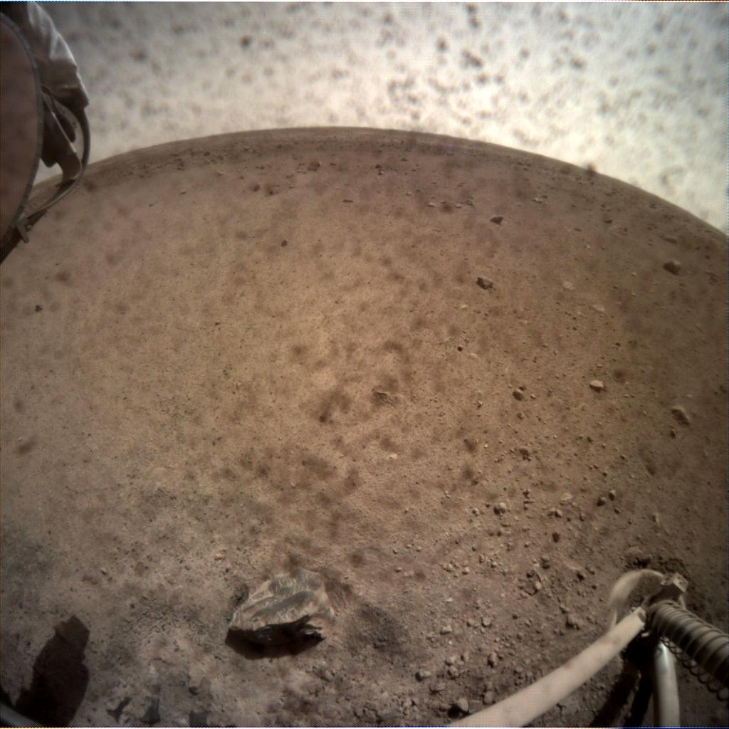NASAs InSight spacecraft flipped open the lens cover on its Instrument Context Camera (ICC) on Nov. 30, 2018, and captured this view of Mars.