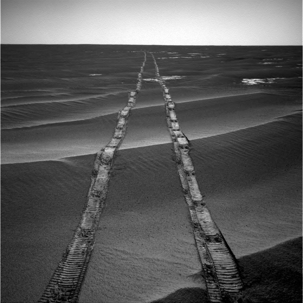 In this navigation camera raw image, NASAs Opportunity Rover looks back over its own tracks on Aug. 4, 2010.