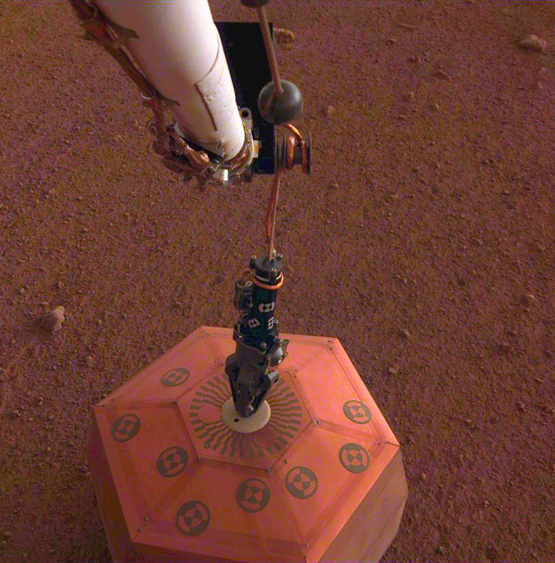 This set of images from the Instrument Deployment Camera shows NASAs InSight lander placing its first instrument onto the surface of Mars, completing a major mission milestone.
