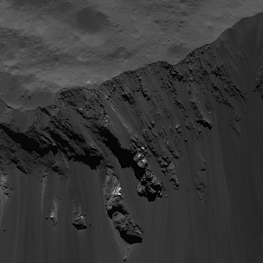 This image of blocks sliding down Occator Craters southeastern wall on Ceres was obtained by NASAs Dawn spacecraft on June 16, 2018 from an altitude of about 24 miles (39 kilometers).