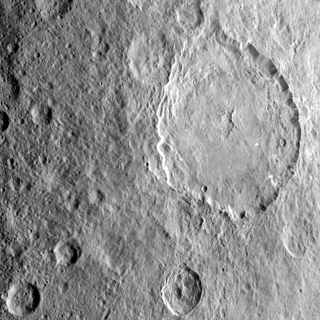 This image shows the complex central construct and concentric fractures in the large Dantu Crater on Ceres, as obtained by NASAs Dawn spacecraft on September 1, 2018 from an altitude of about 1335 miles (2150 kilometers).