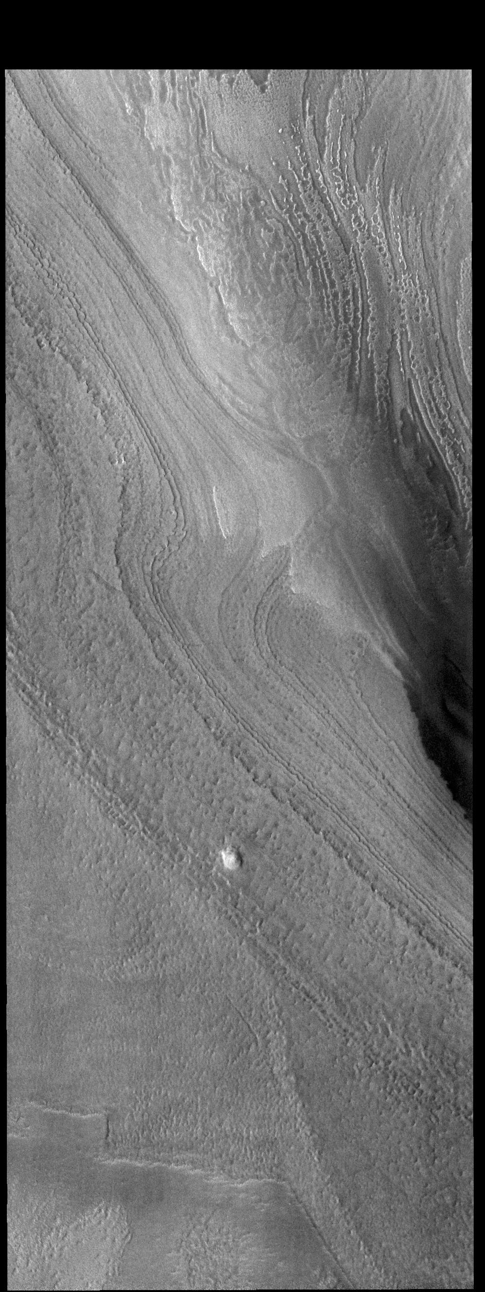 This image from NASAs Mars Odyssey shows a small part of the south polar cap. The layers record the seasonal deposition of dust and ice over the course of 1000s of years.