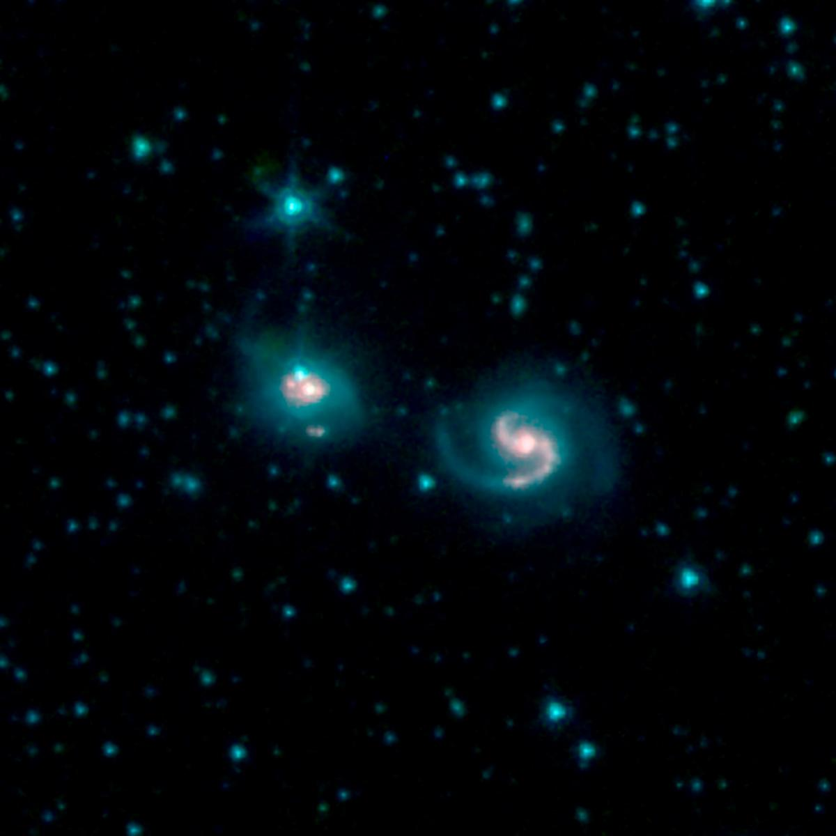 This image, by NASAs Spitzer Space Telescope, shows the merger of two galaxies, known as NGC 6786 (right) and UGC 11415 (left), also collectively called VII Zw 96.