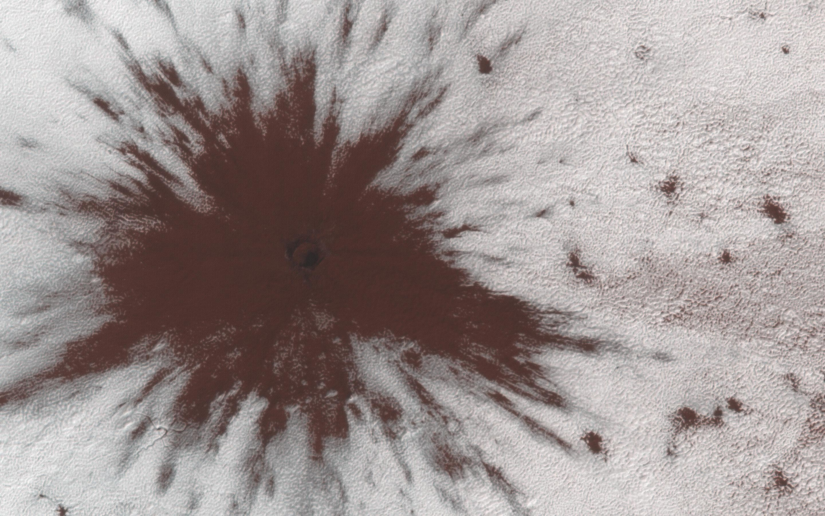 This image acquired on October 5, 2018 by NASAs Mars Reconnaissance Orbiter, shows a new impact crater that formed between July and September 2018.