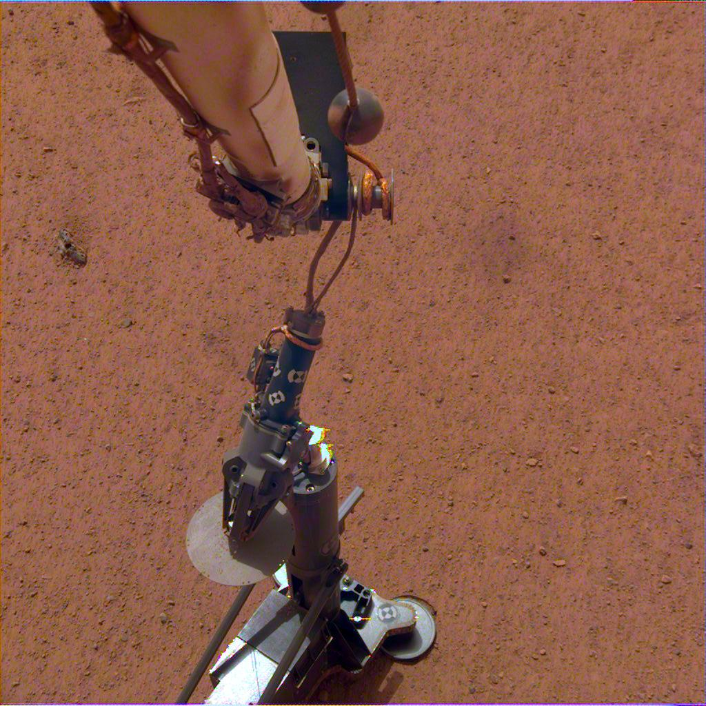 NASAs InSight lander set its heat probe, called the Heat and Physical Properties Package (HP3), on the Martian surface on Feb. 12, 2019.