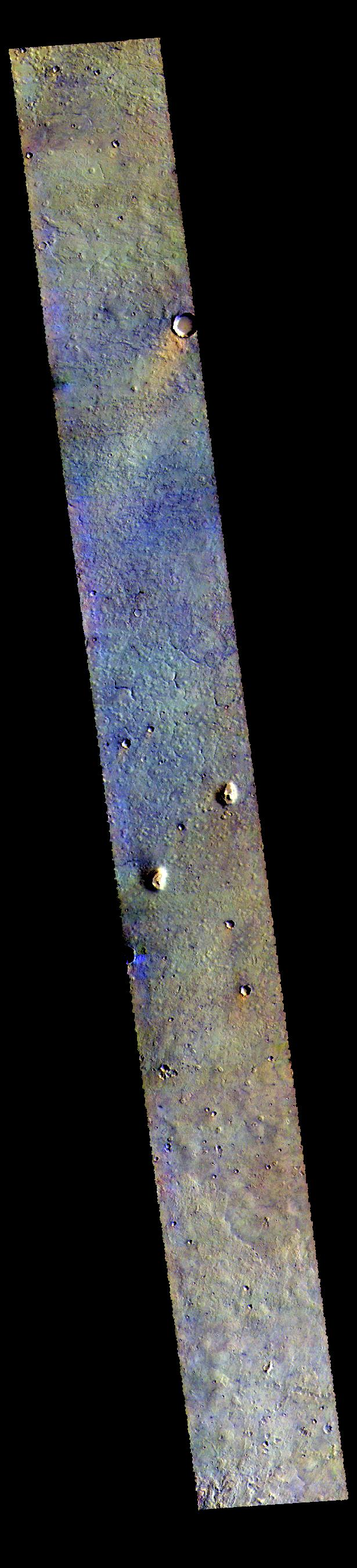 This image from NASAs Mars Odyssey shows the plains between Chryse and Acidalia Planitias. Dark blue tones in this false color combination are usually created by basaltic sands.