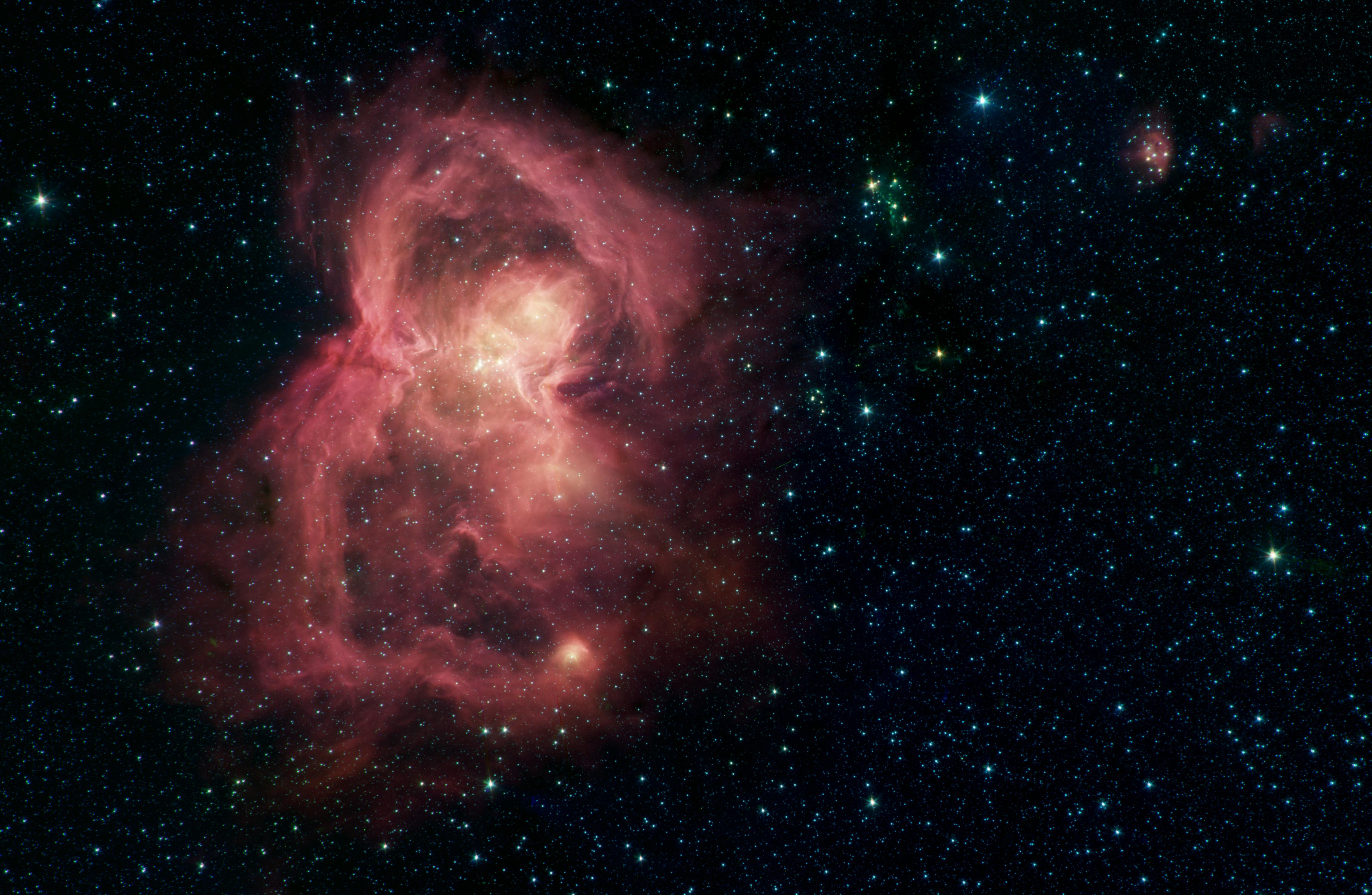 This image by NASAs Spitzer Space Telescope shows W40, a nebula, or a giant cloud of gas and dust.