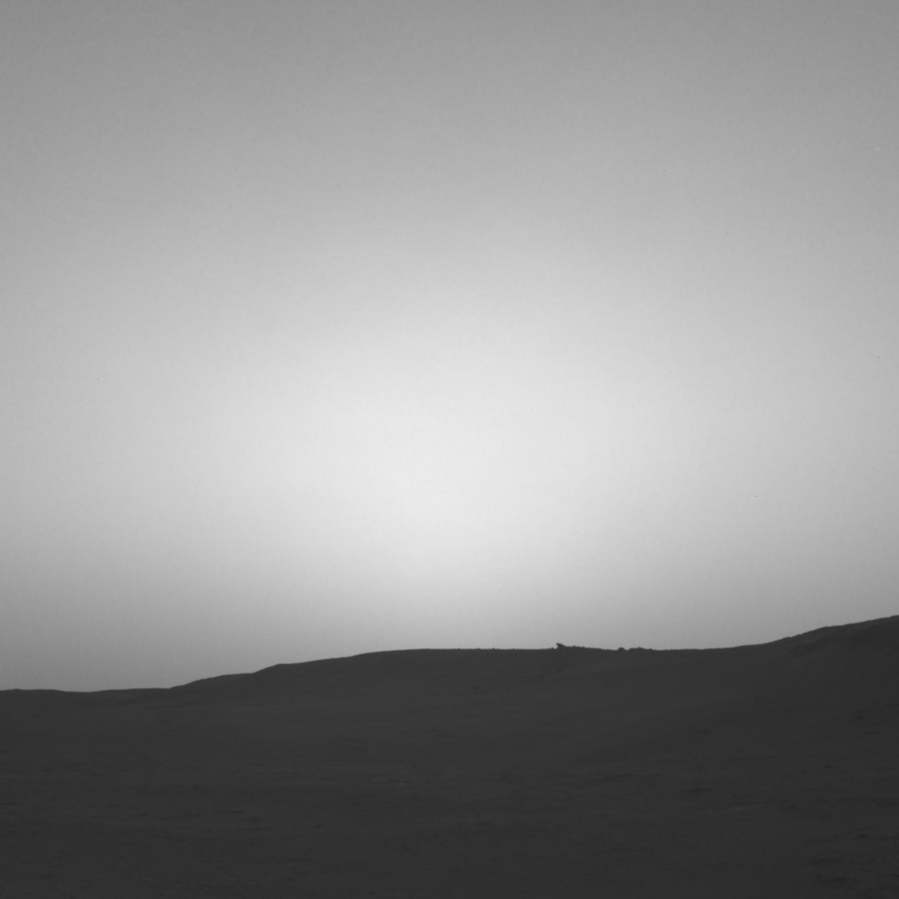 This series of images shows the shadow of Phobos as it sweeps over NASAs Curiosity Mars rover and darkens the sunlight on Monday, March 25, 2019 (Sol 2358).
