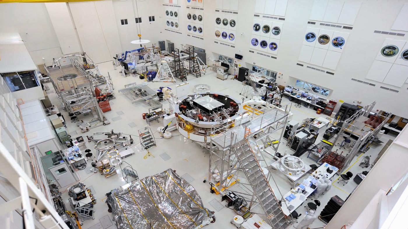 This image shows major components of NASAs Mars 2020 mission in the High Bay 1 clean room in JPLs Spacecraft Assembly Facility.