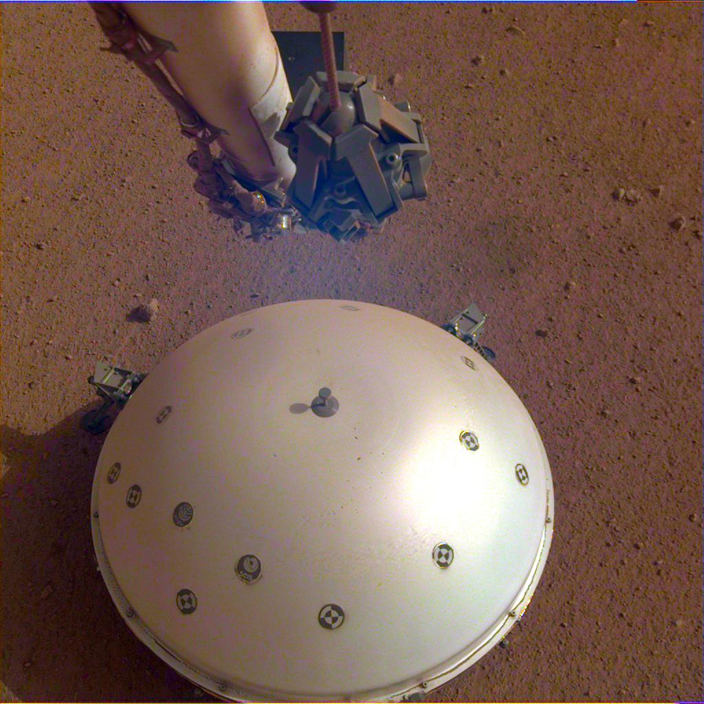 This image shows NASAs InSight landers domed Wind and Thermal Shield, which covers its seismometer. The image was taken on the 110th Martian day, or sol, of the mission.
