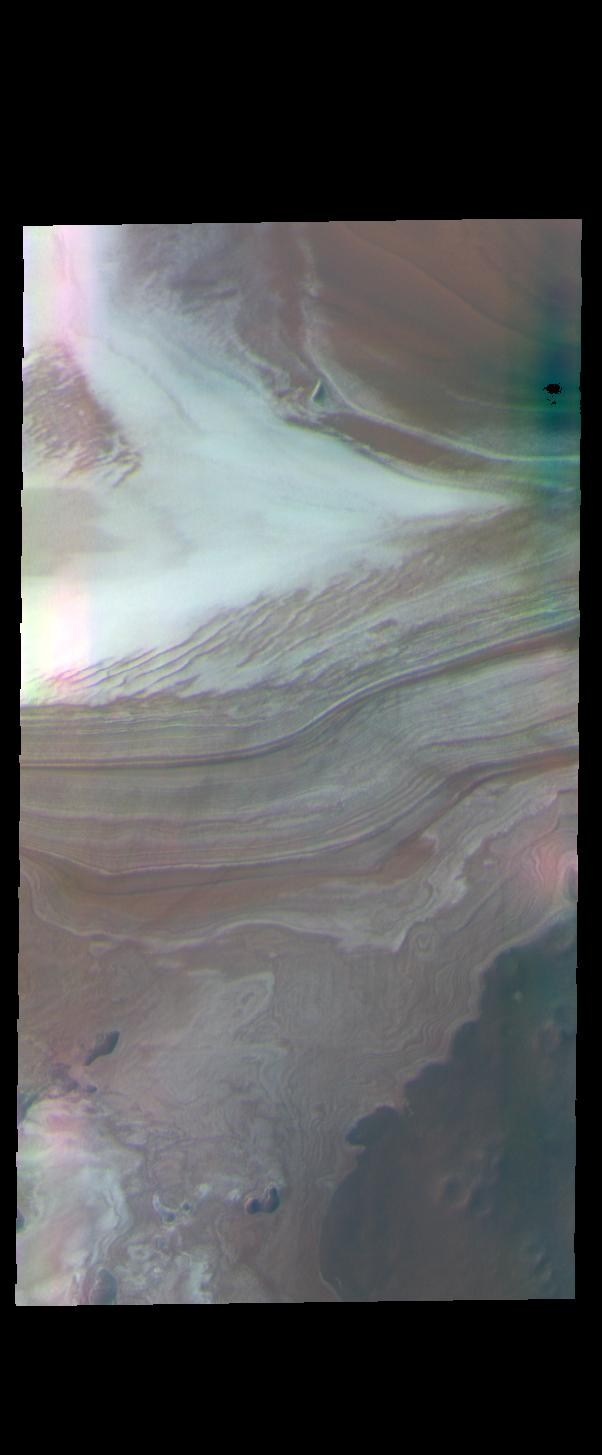 This image from NASAs Mars Odyssey shows the margin between the north polar cap and the surrounding plains.