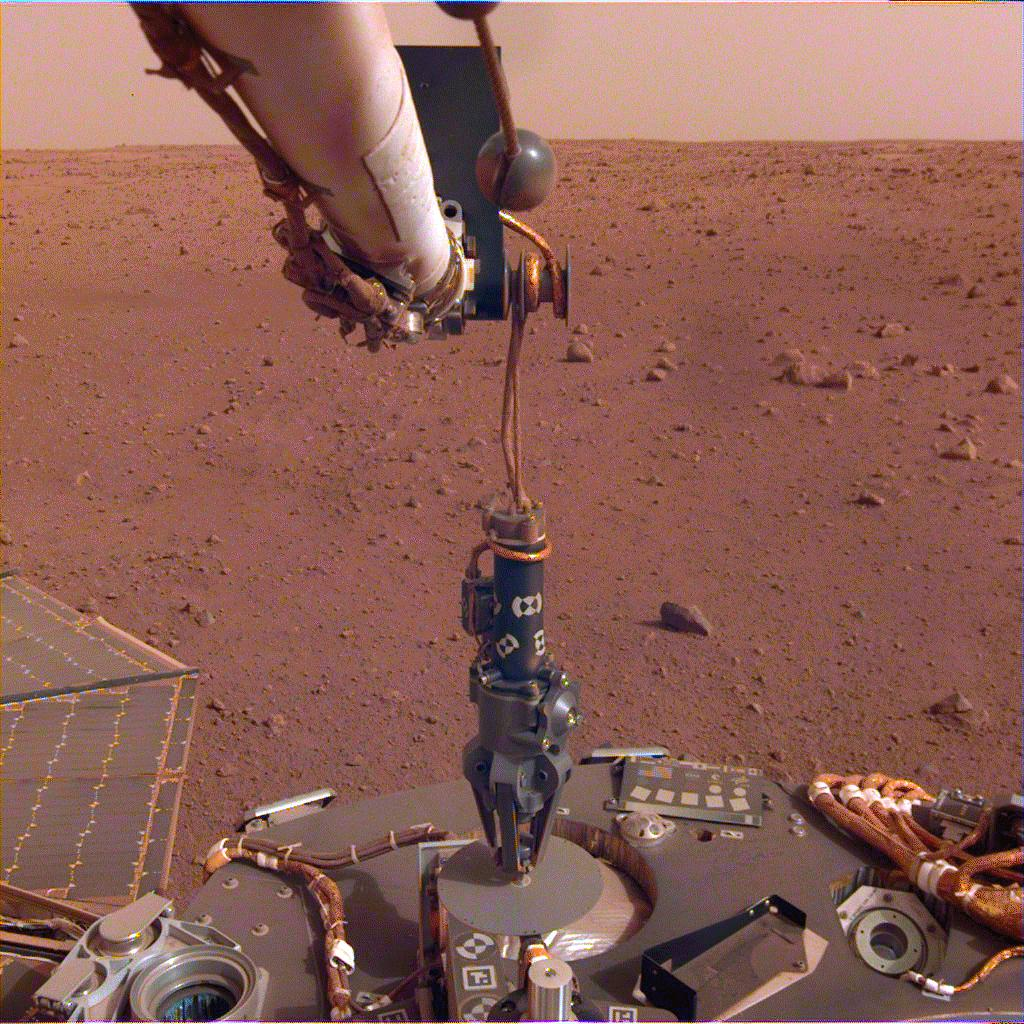 The robotic arm on NASAs InSight lander deployed its Heat Flow and Physical Properties Package (HP3) instrument on the Martian surface on Feb. 12, 2019.