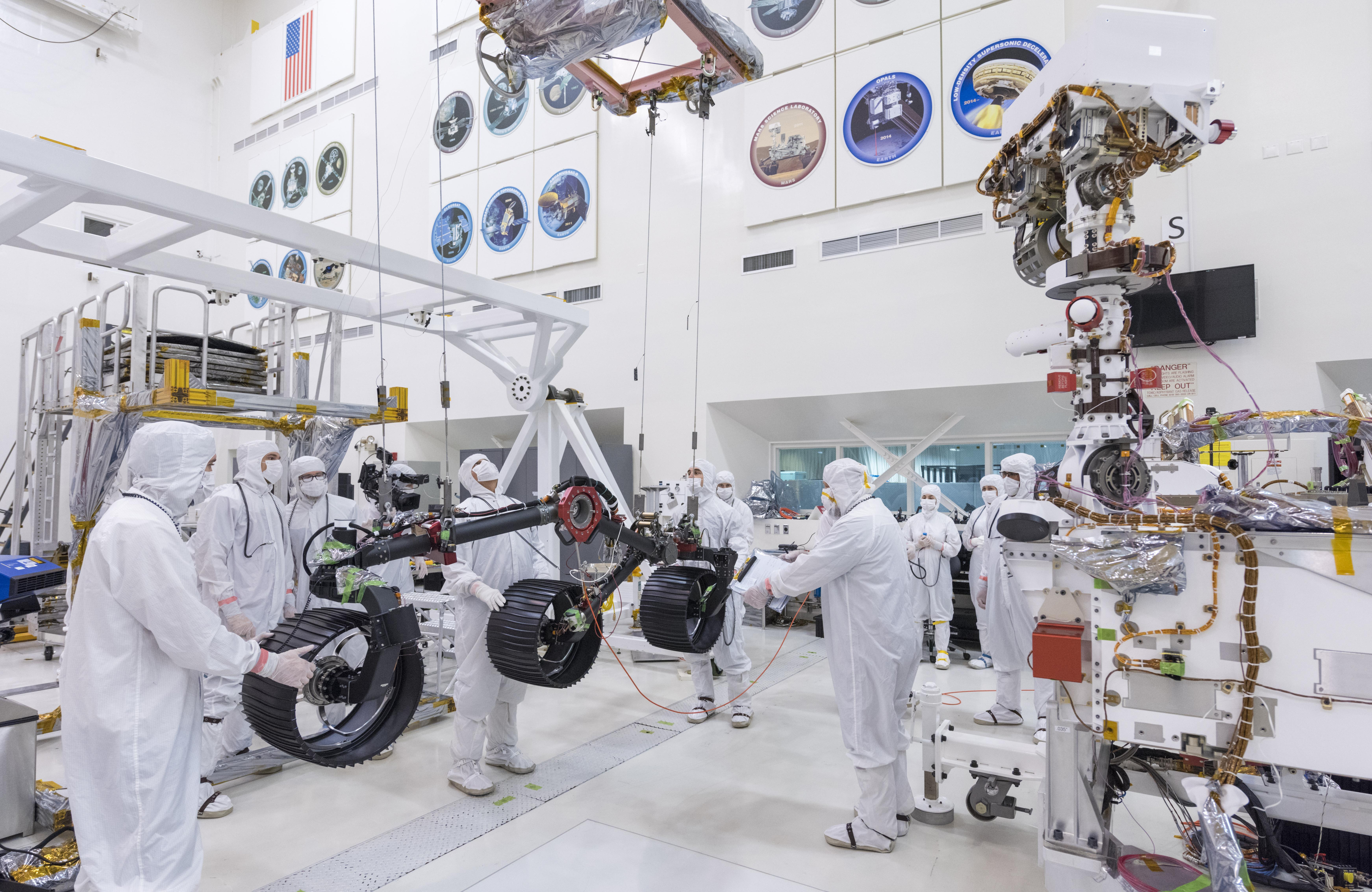 In this image, taken on June 13, 2019, engineers prepare the starboard legs and wheels for integration onto NASAs Mars 2020 rover.