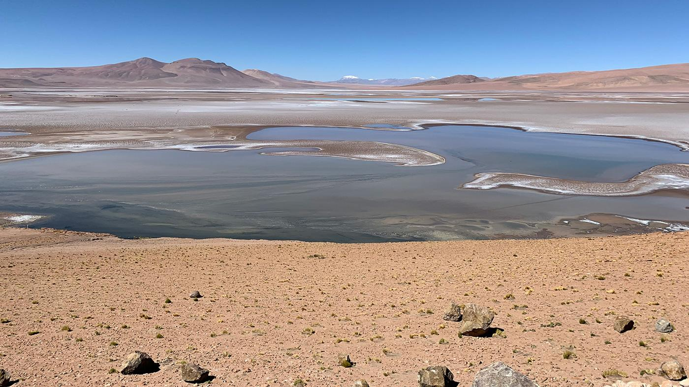 Filled with briny lakes, the Quisquiro salt flat in South Americas Altiplano represents the kind of landscape that scientists think may have existed in Gale Crater, which NASAs Curiosity rover is exploring.