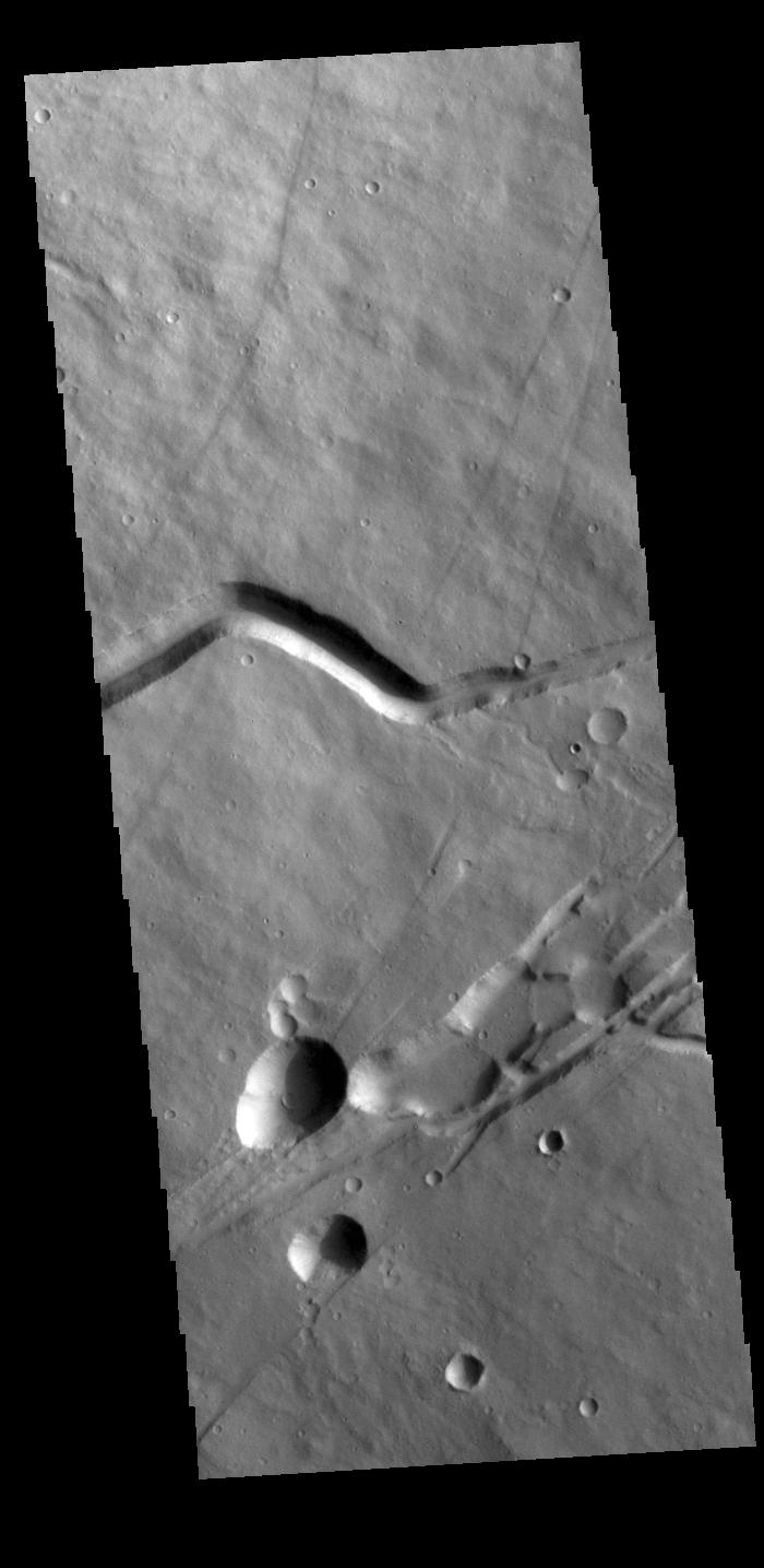 This image from NASAs Mars Odyssey shows a portion of the flank of Albor Tholus, a volcano found in the Elysium volcanic complex.