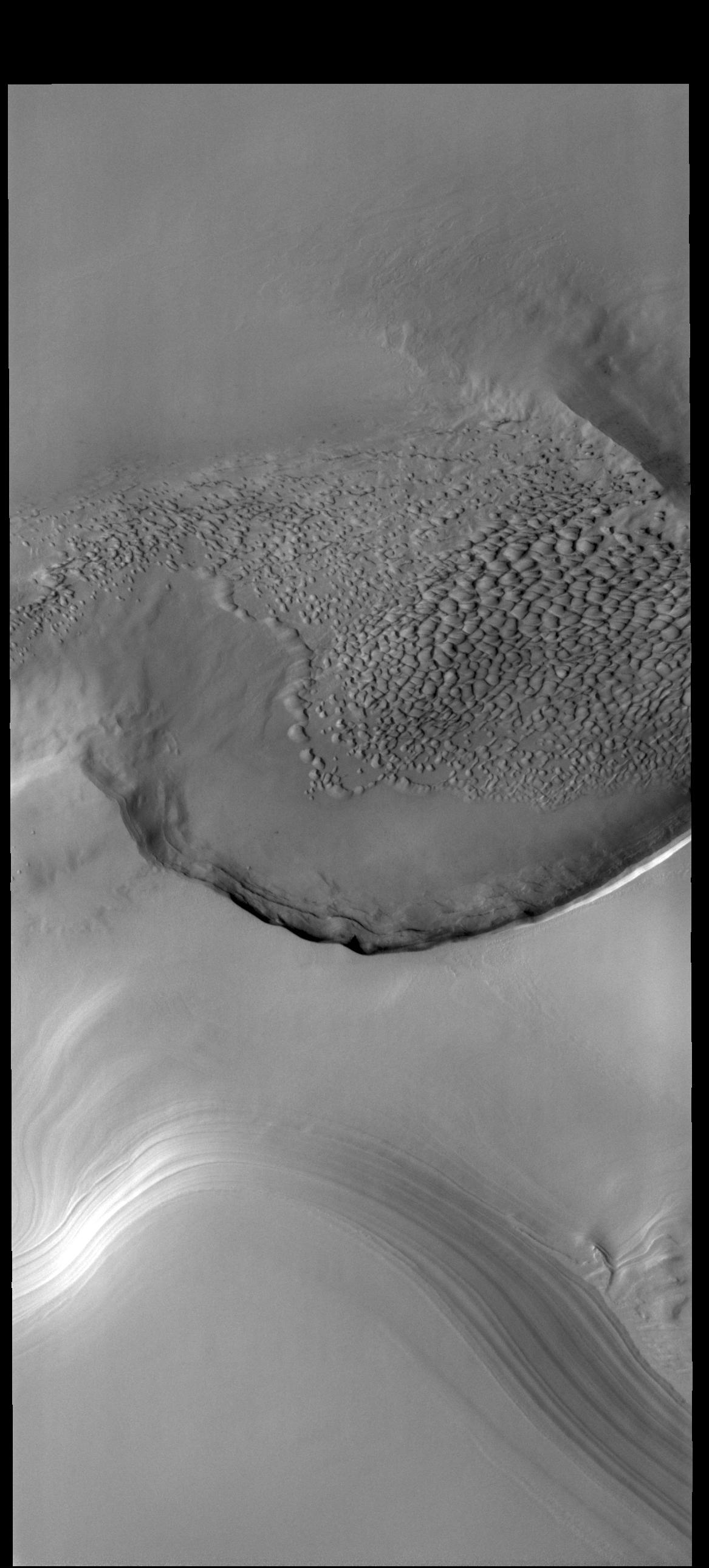 This image from NASAs Mars Odyssey shows the edge of the polar cap.