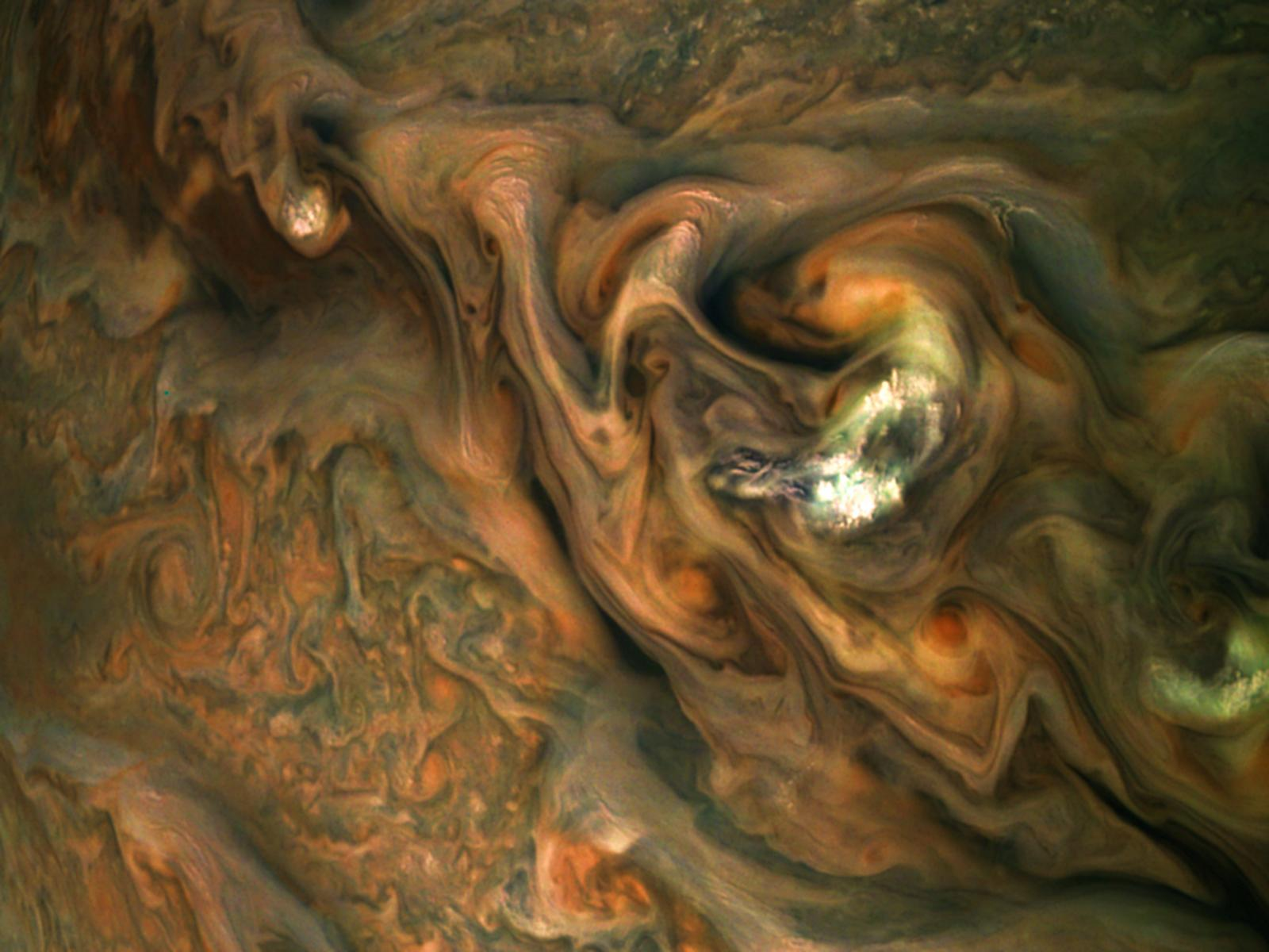 This view from NASAs Juno spacecraft captures colorful, intricate patterns in a jet stream region of Jupiters northern hemisphere known as Jet N3.
