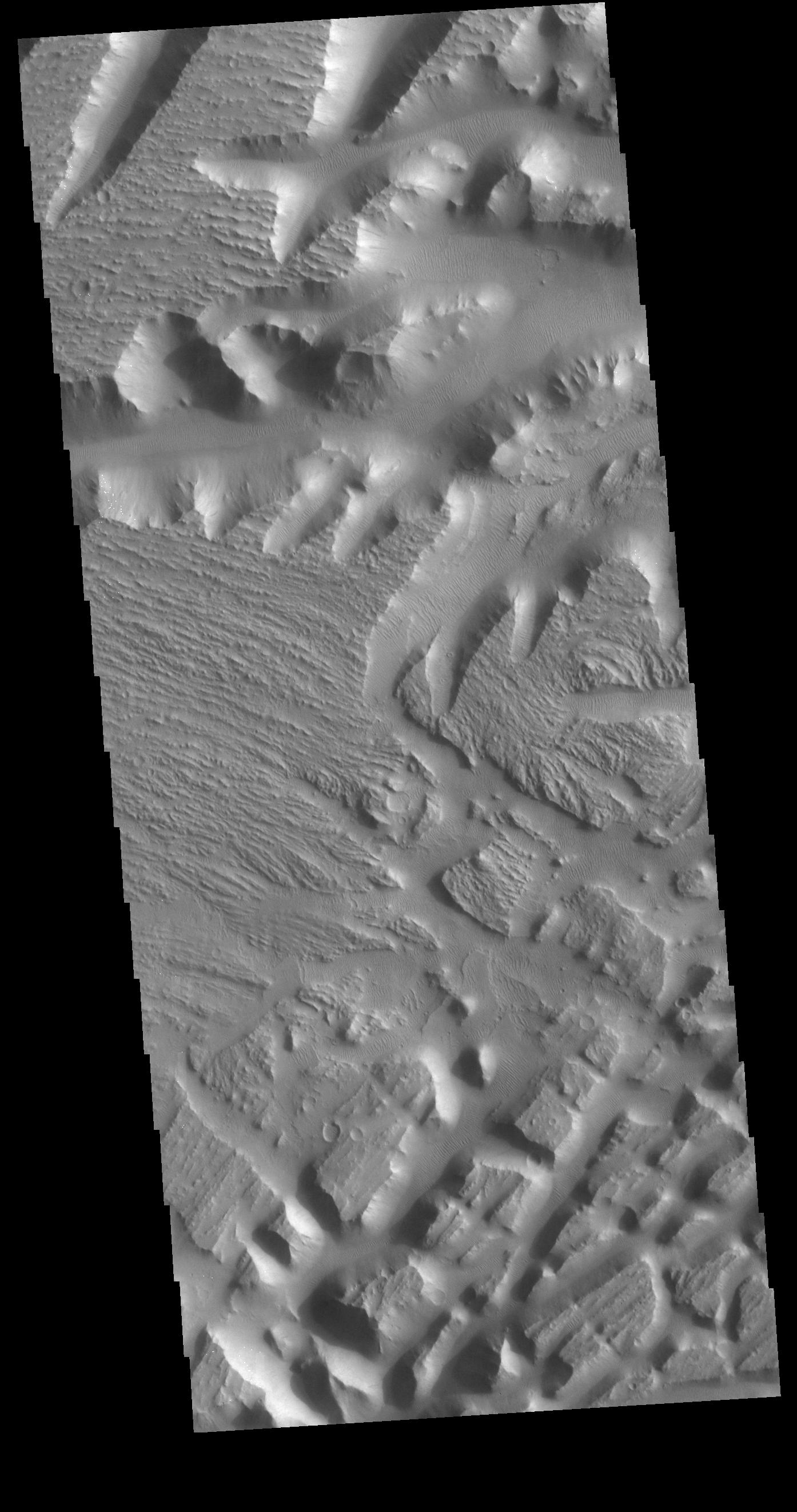 This image from NASAs Mars Odyssey shows part of Nilus Mensae, a complex region of tectonic faulting and fluid flow features.