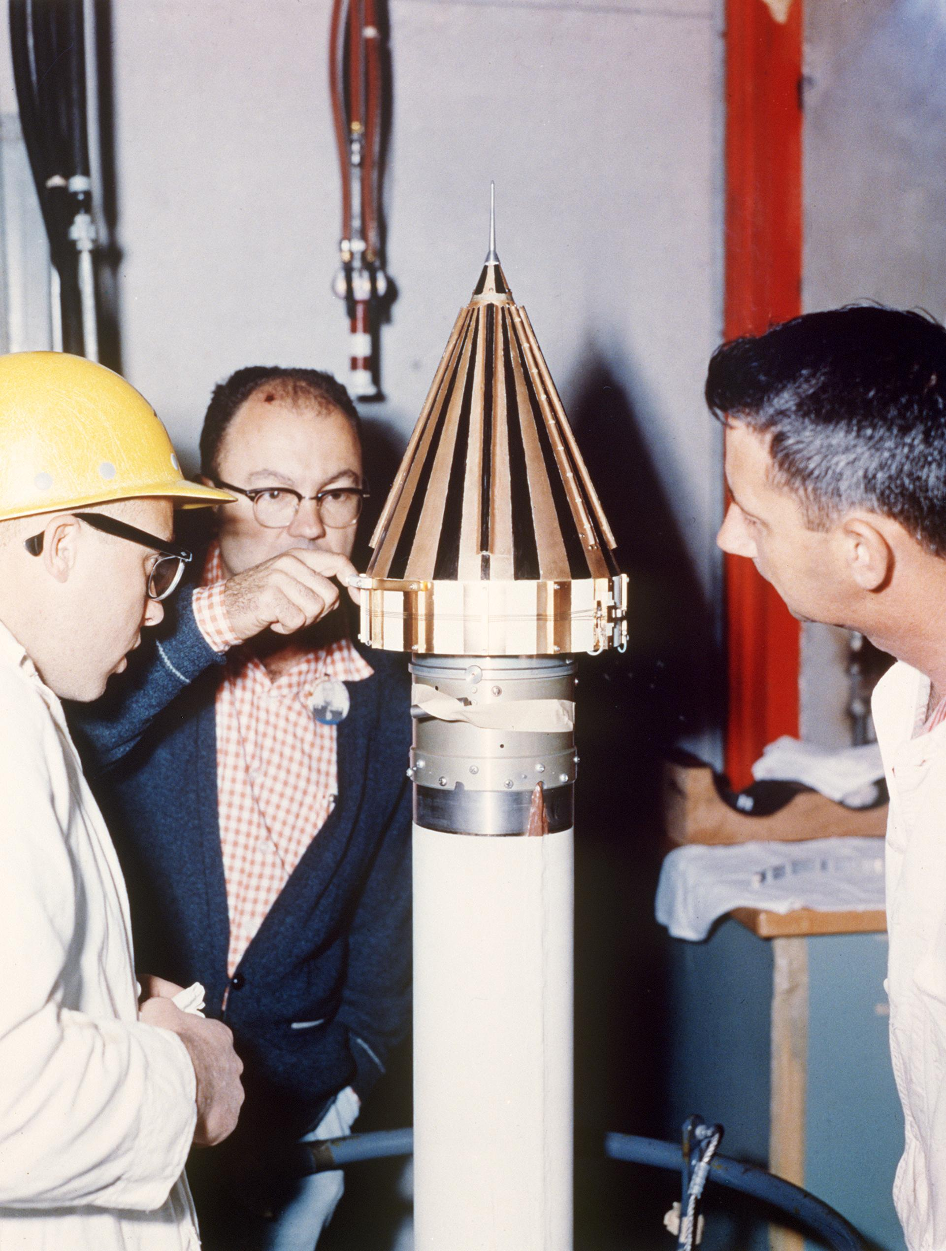 This image from March 2, 1959 shows engineers from NASAs Jet Propulsion Laboratory checking NASAs Pioneer 4 spacecraft.