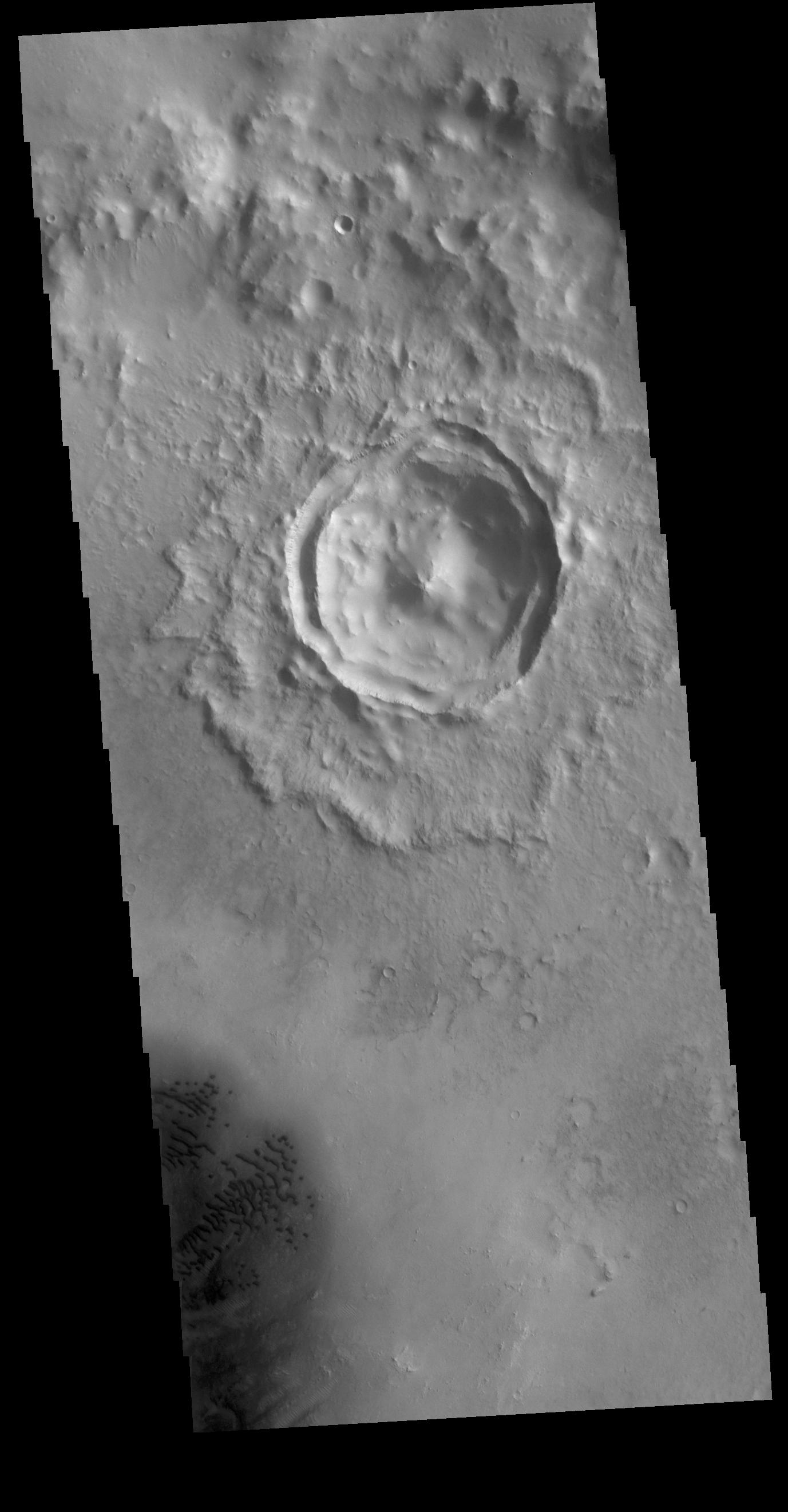 This image from NASAs Mars Odyssey shows an unnamed crater located in Arabia Terra. The small crater seen in the image is located on the floor of a much larger crater.