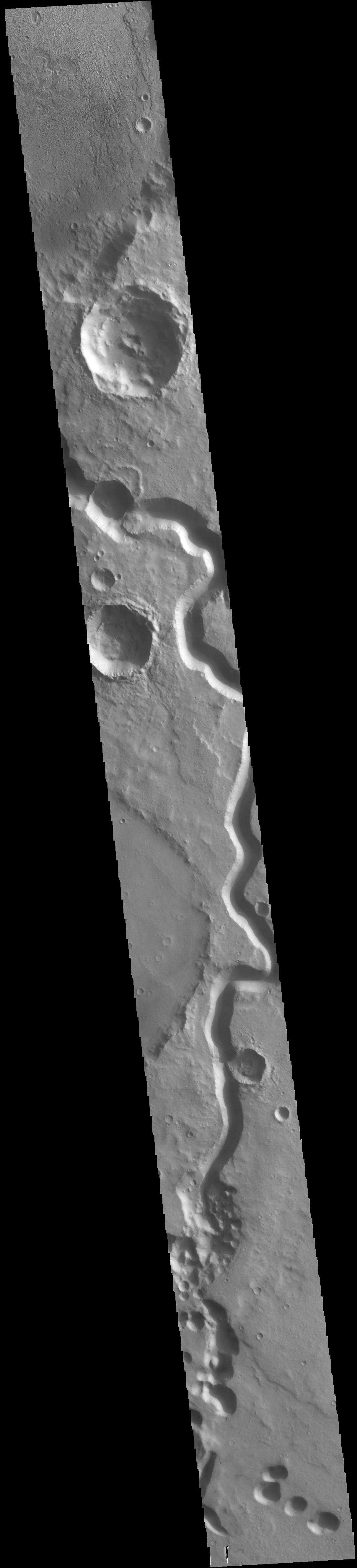 This image from NASAs Mars Odyssey shows a sinuous channel, Tinto Vallis.