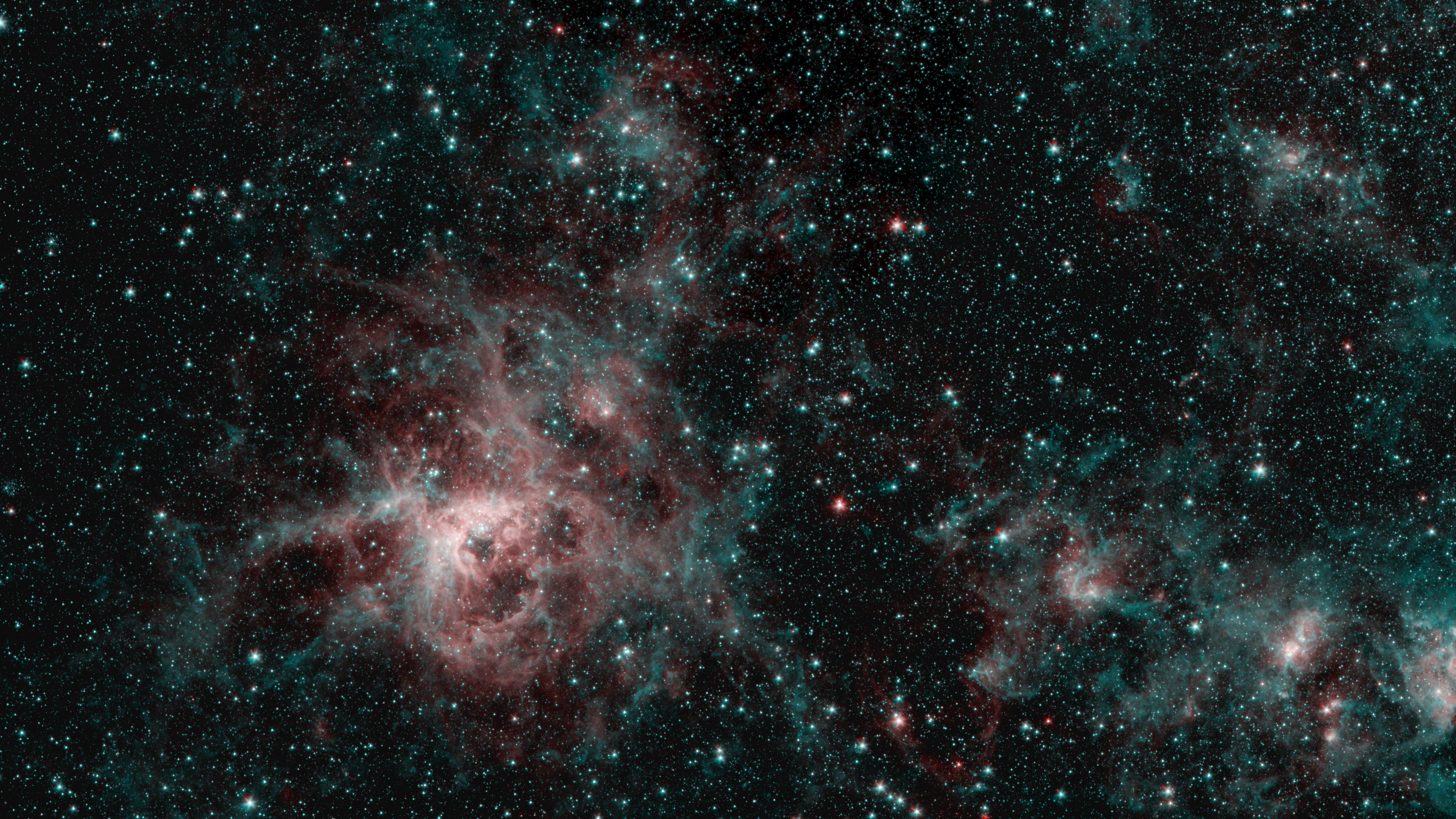 This image from NASAs Spitzer Space Telescope shows the Tarantula Nebula in two wavelengths of infrared light, each represented by a different color.