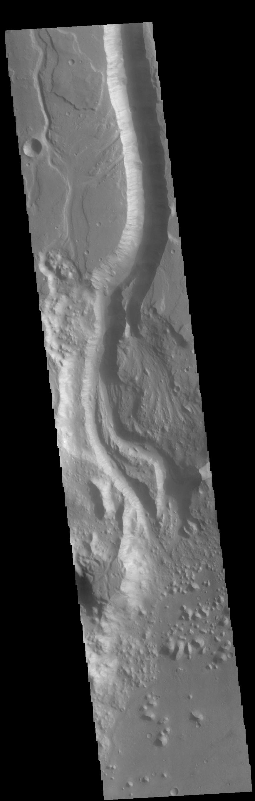 This image from NASAs Mars Odyssey shows a section of Shalbatana Vallis. Shalbatana Vallis is located in Xanthe Terra and is one of many channels that empty into Chryse Planitia.
