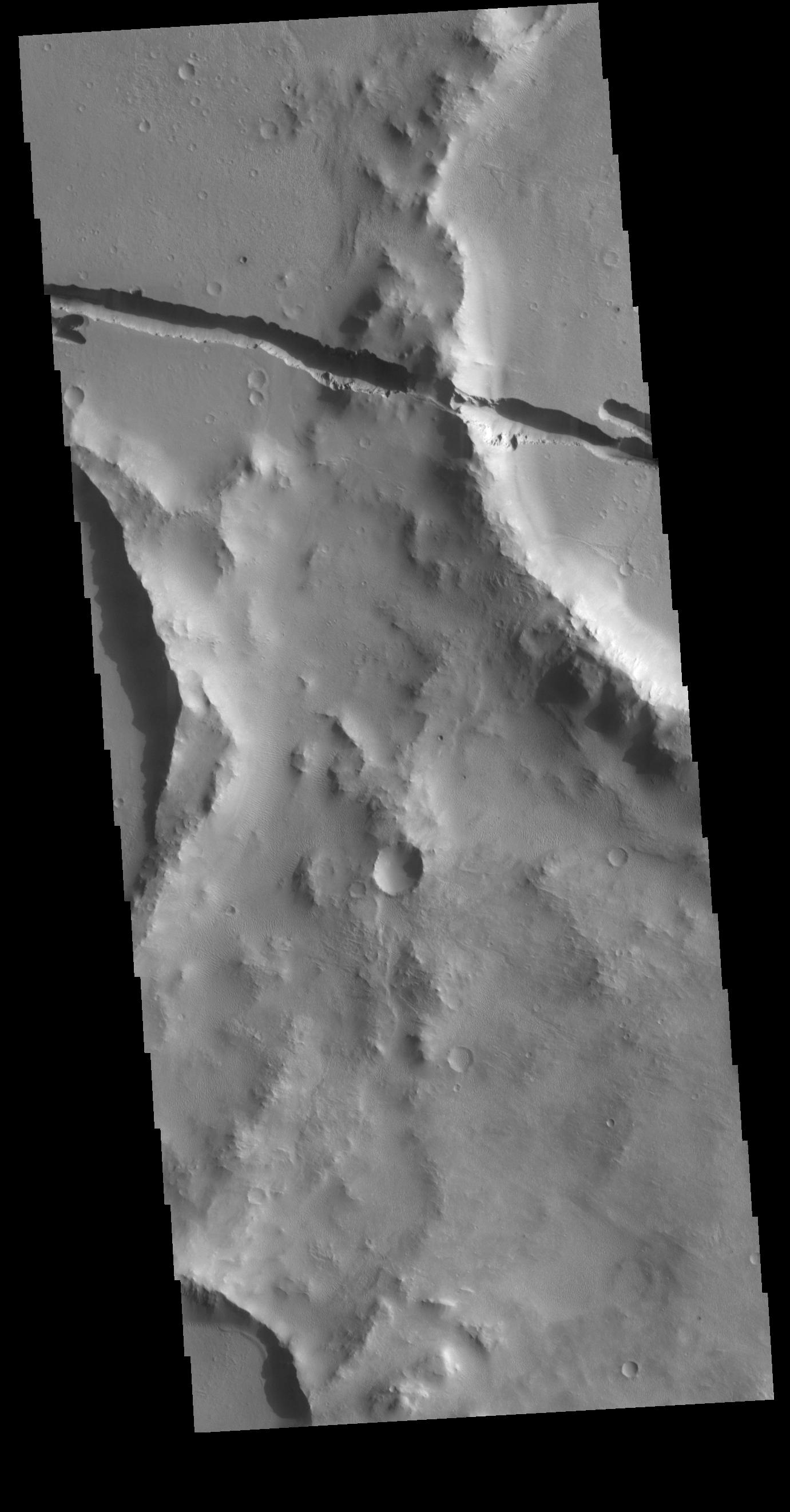 This image from NASAs Mars Odyssey shows a section of Cerberus Fossae.